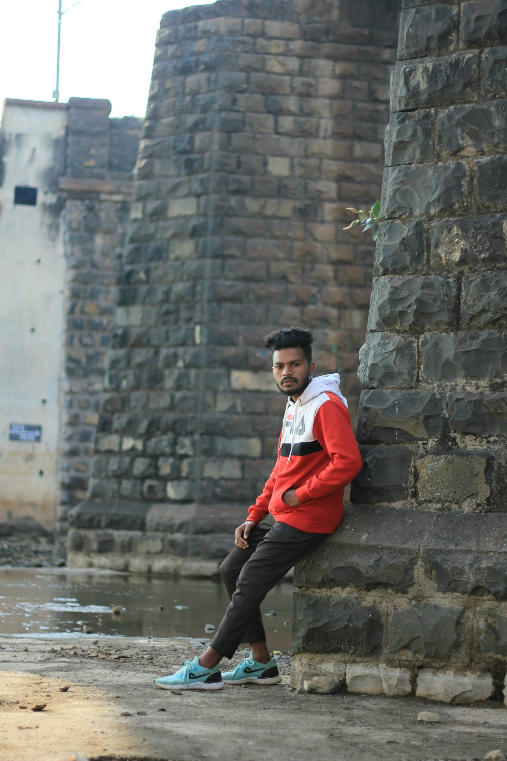 Male model posing against the wall