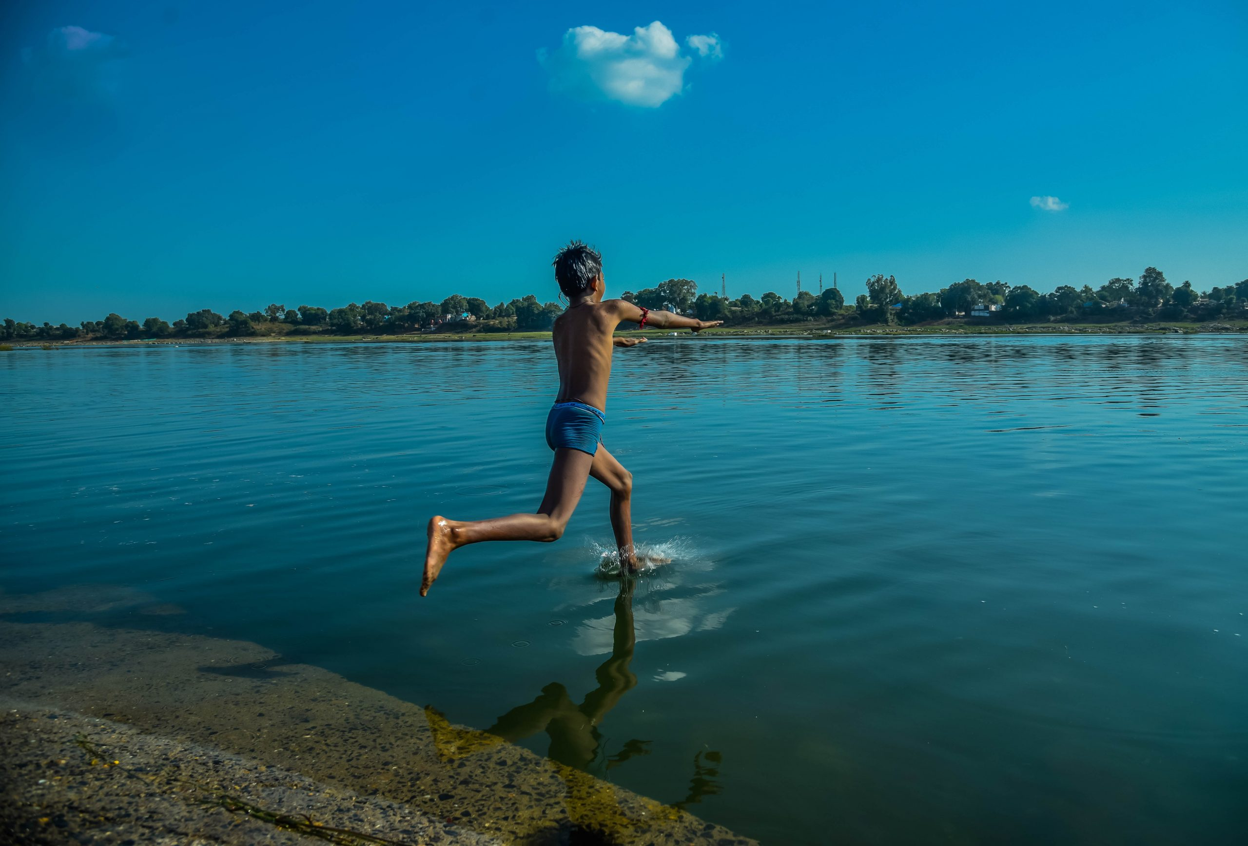 Man jumping into the river