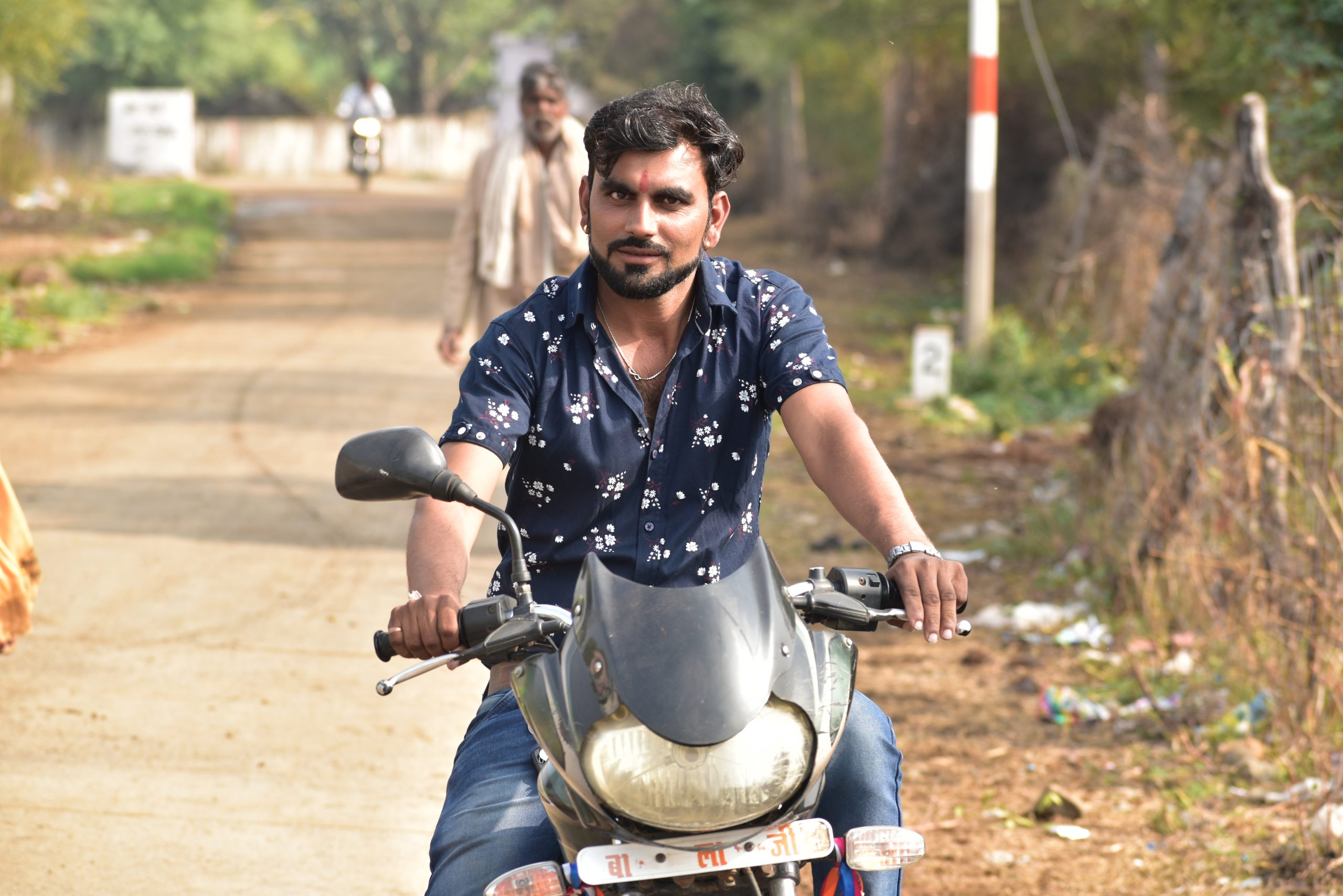 A village man driving a bike