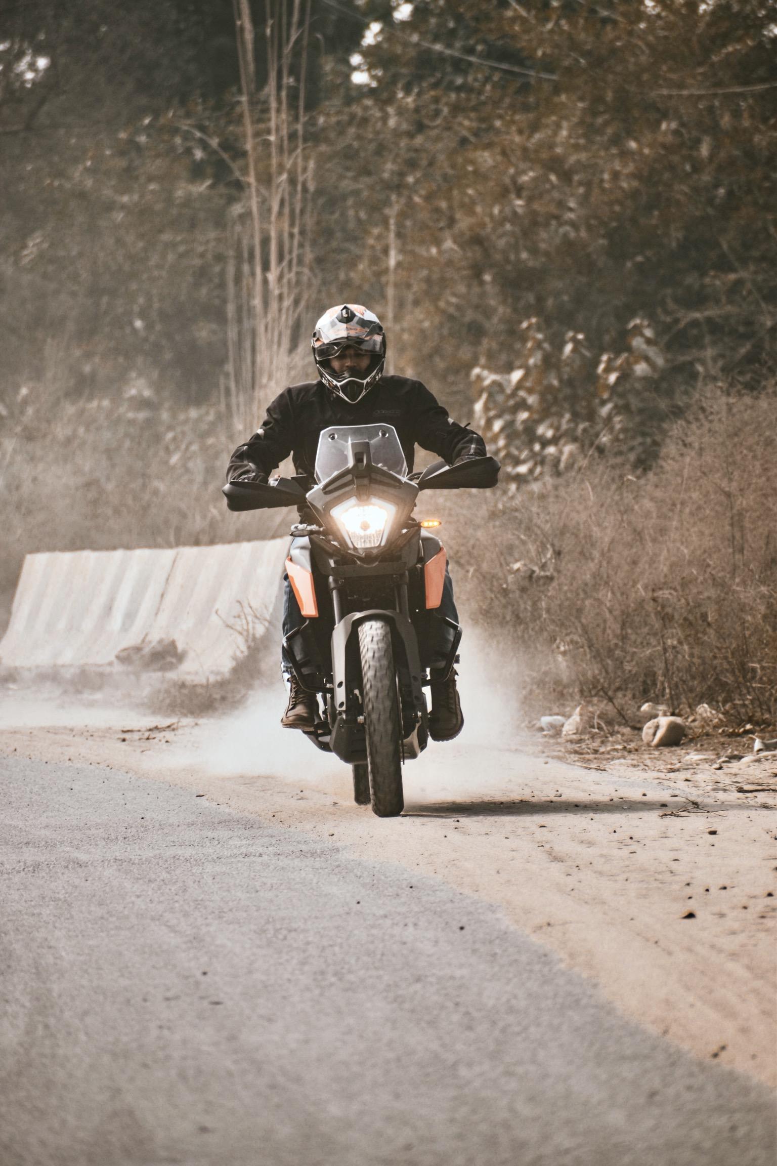 Man riding KTM bike on road