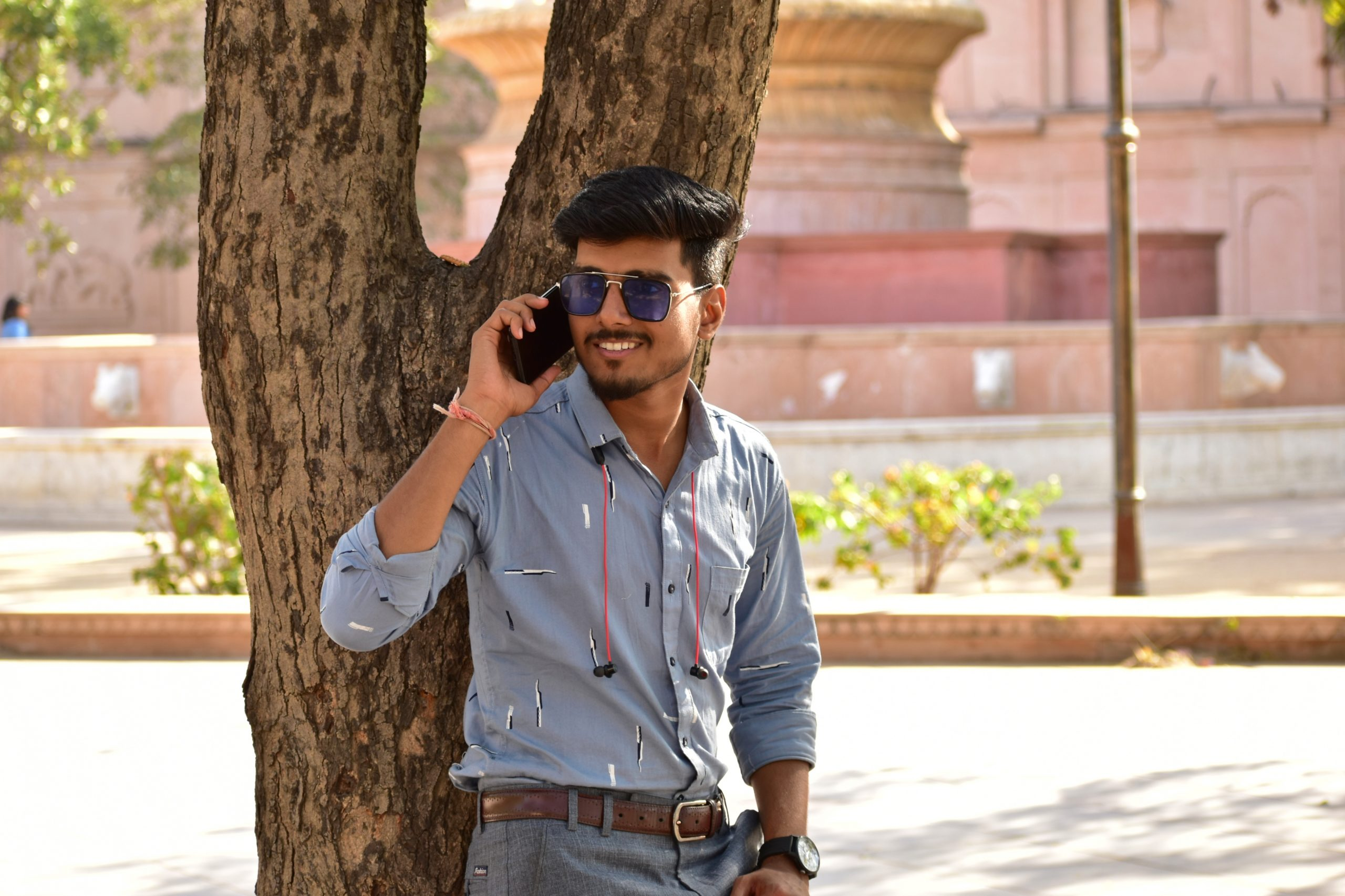 Man talking on phone and posing