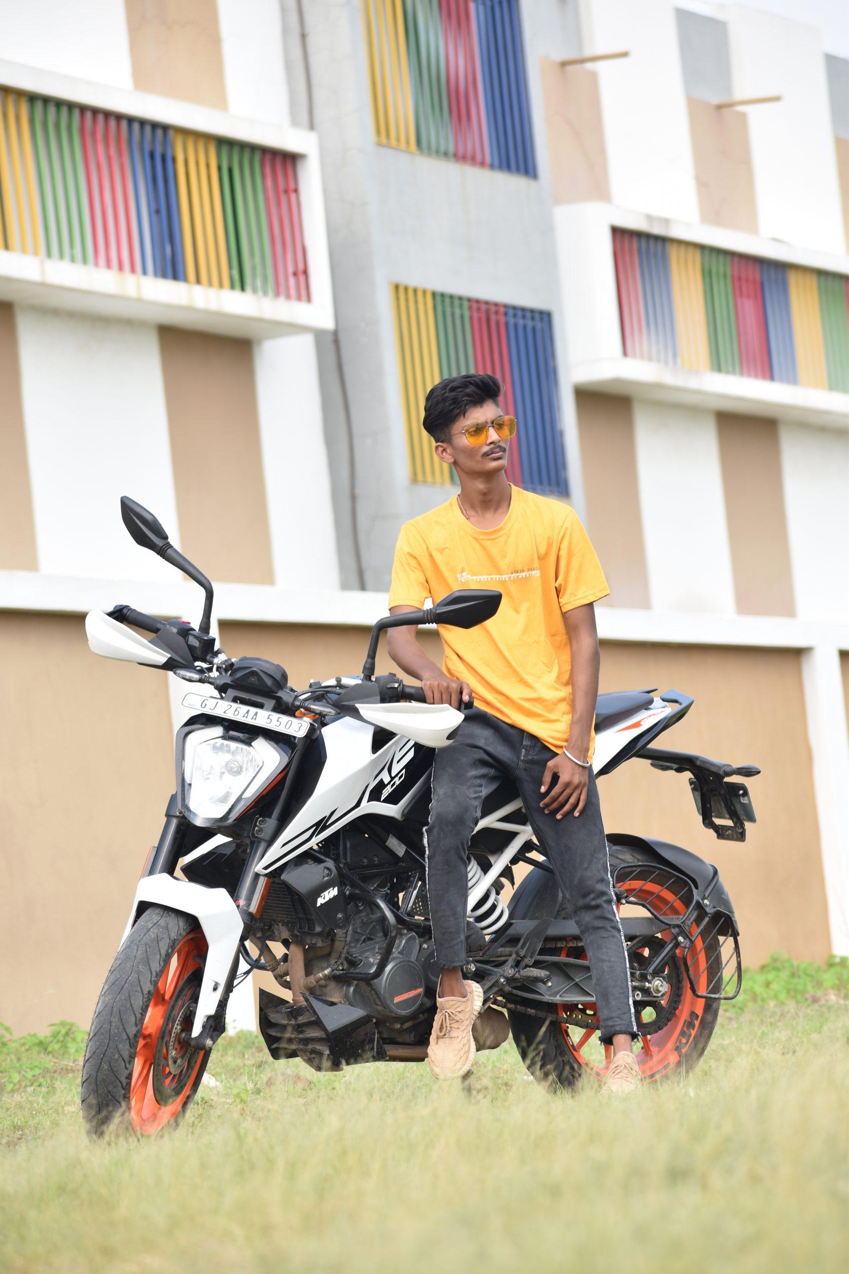 Model posing with Duke bike
