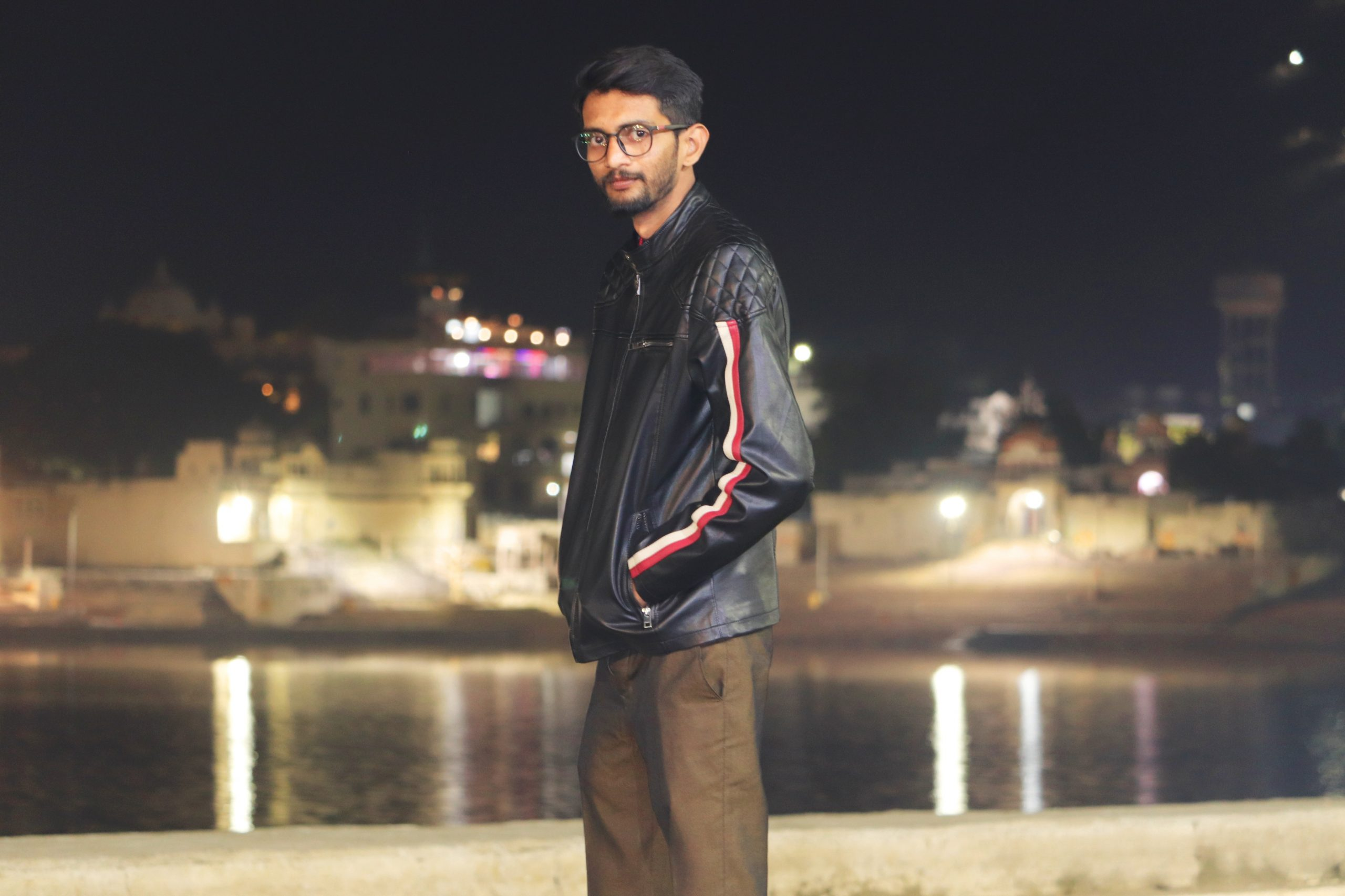 Model boy posing in the night