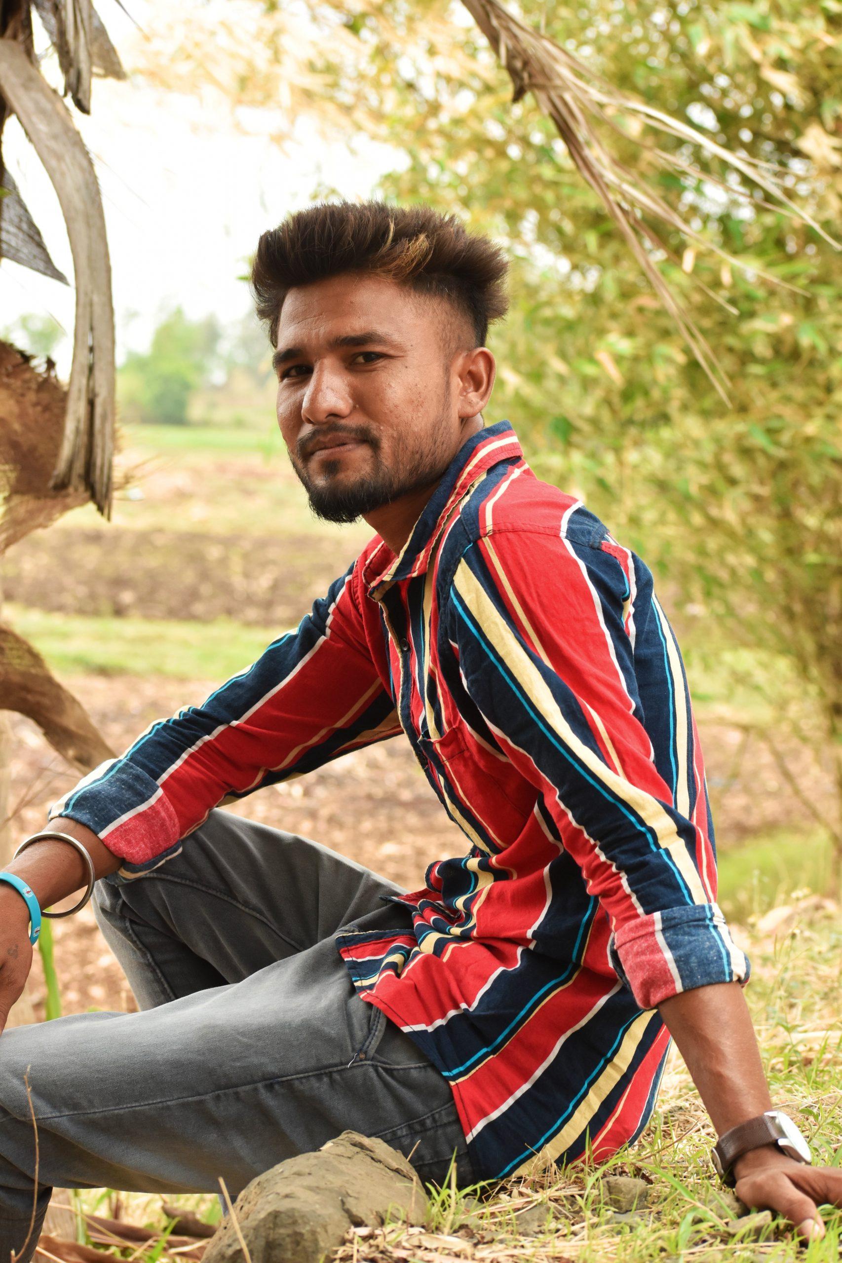 Model boy posing in farm