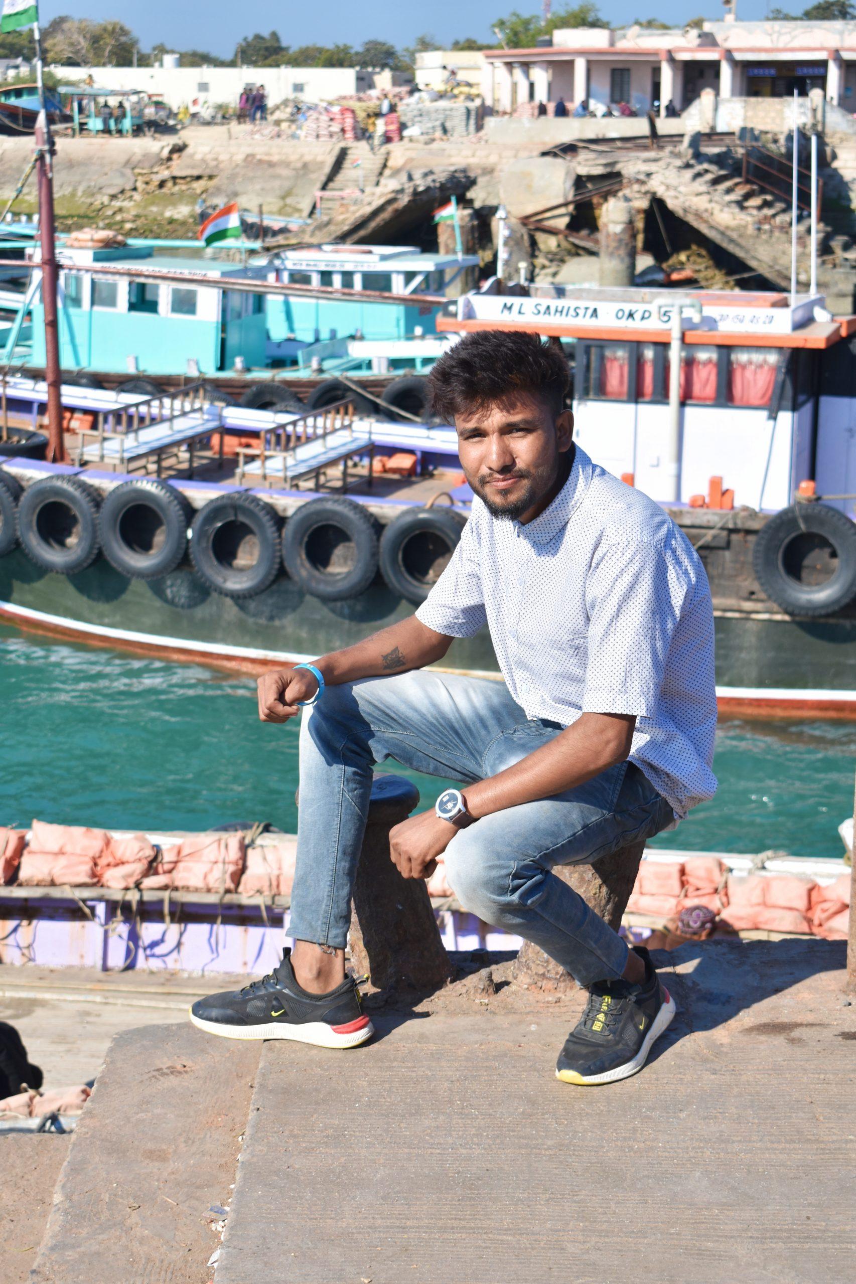 A boy at a dockyard
