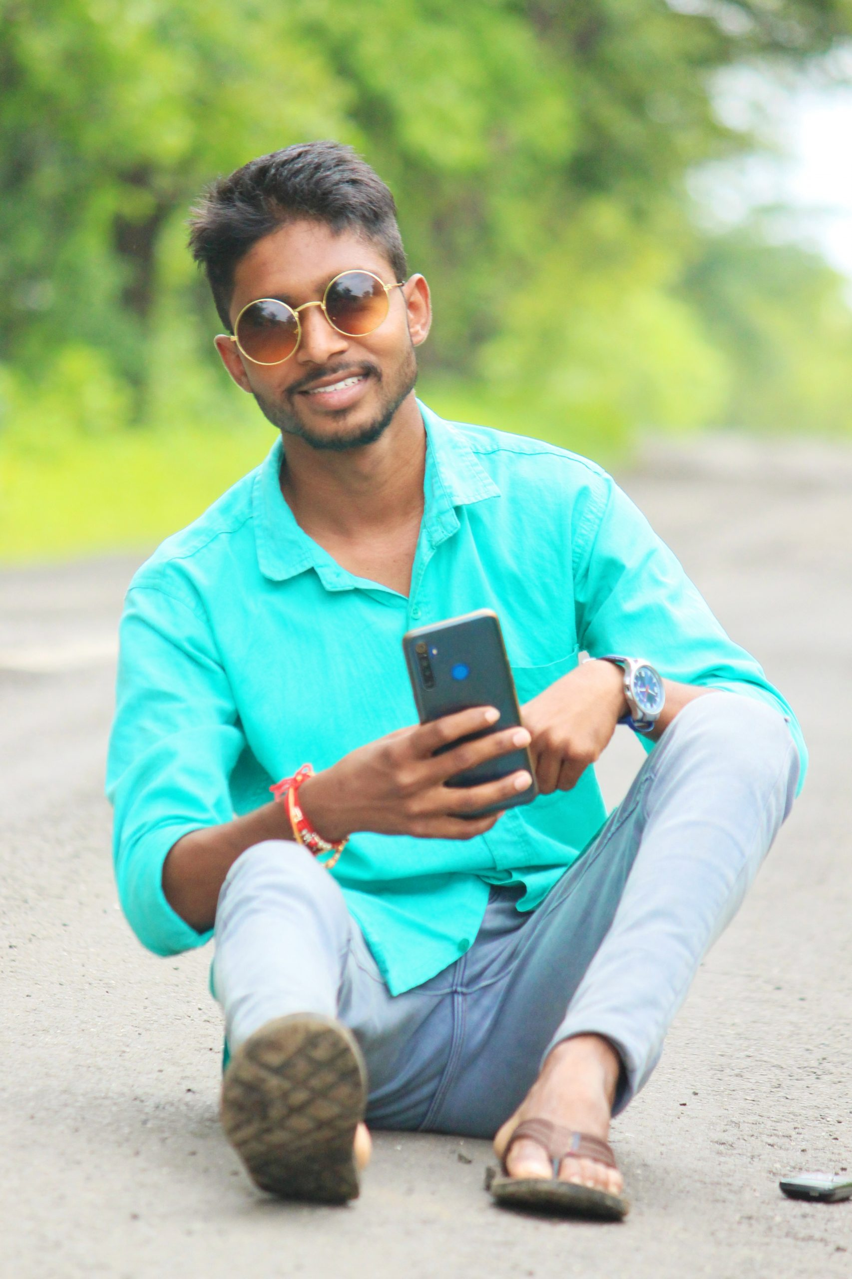 Model posing with cellphone on road