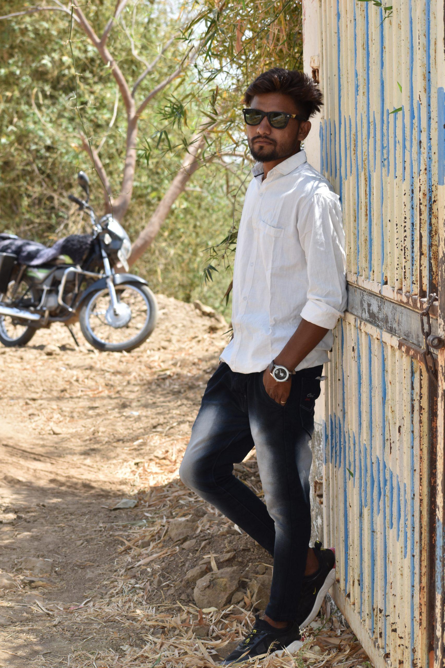 Model posing against the gate