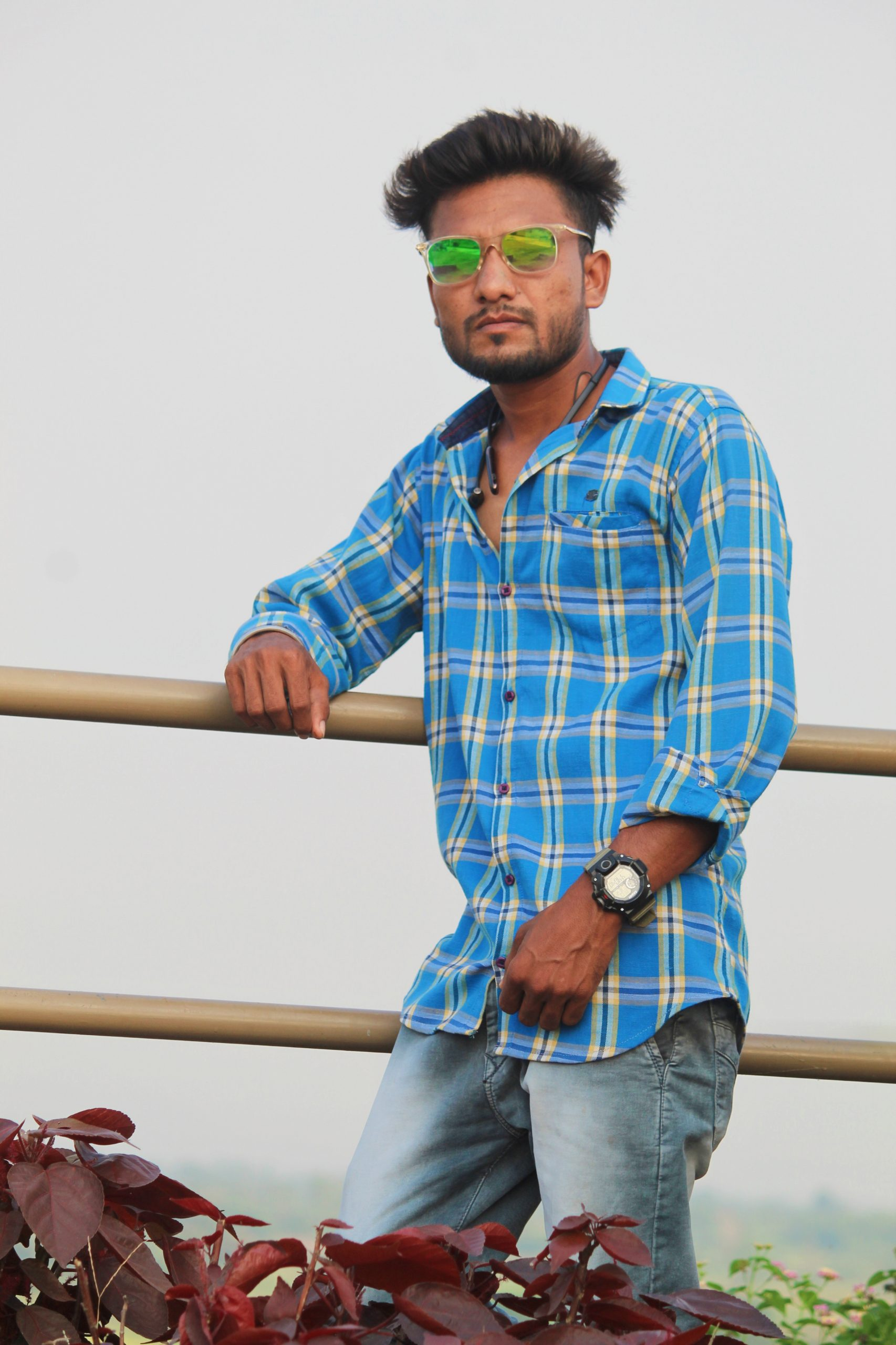 Model posing against the railing