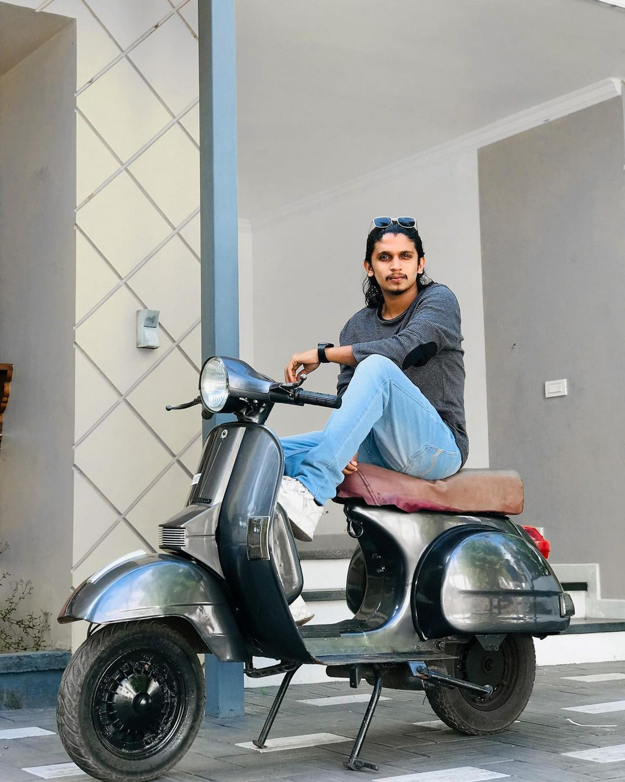 Model posing on scooter