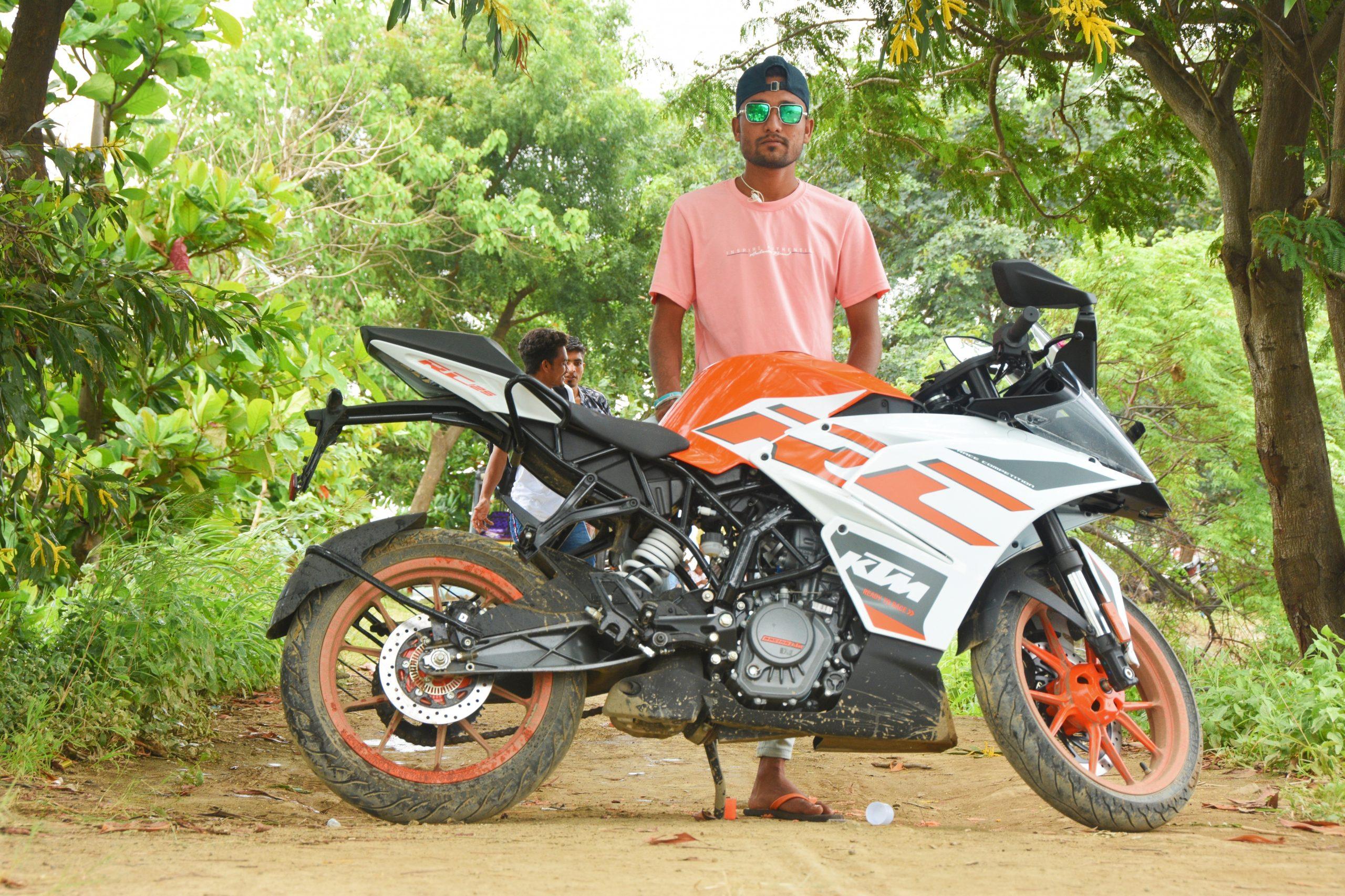 Model posing on KTM bike