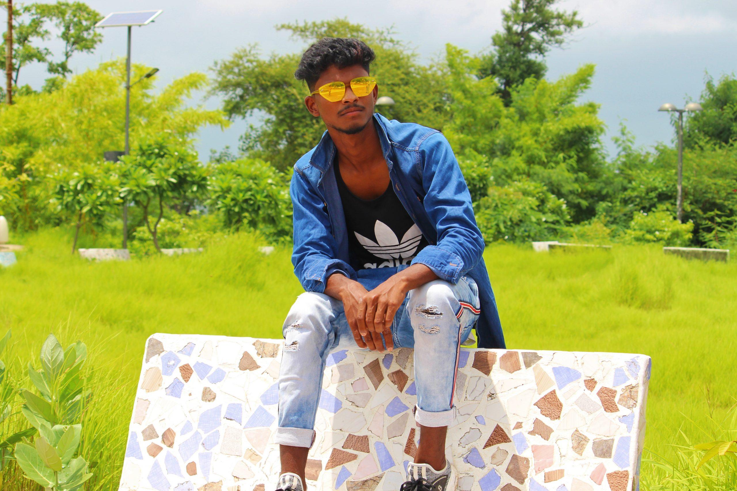 Model posing in garden with sunglasses