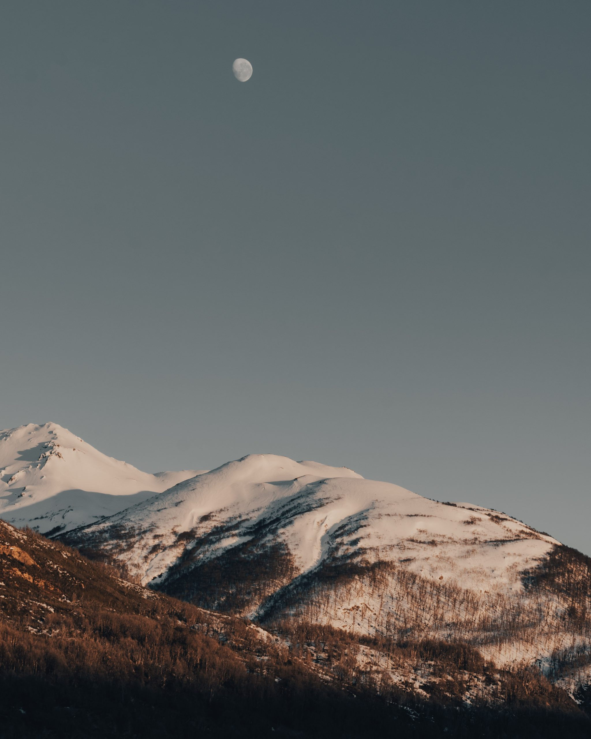 Moon and snowy mountains
