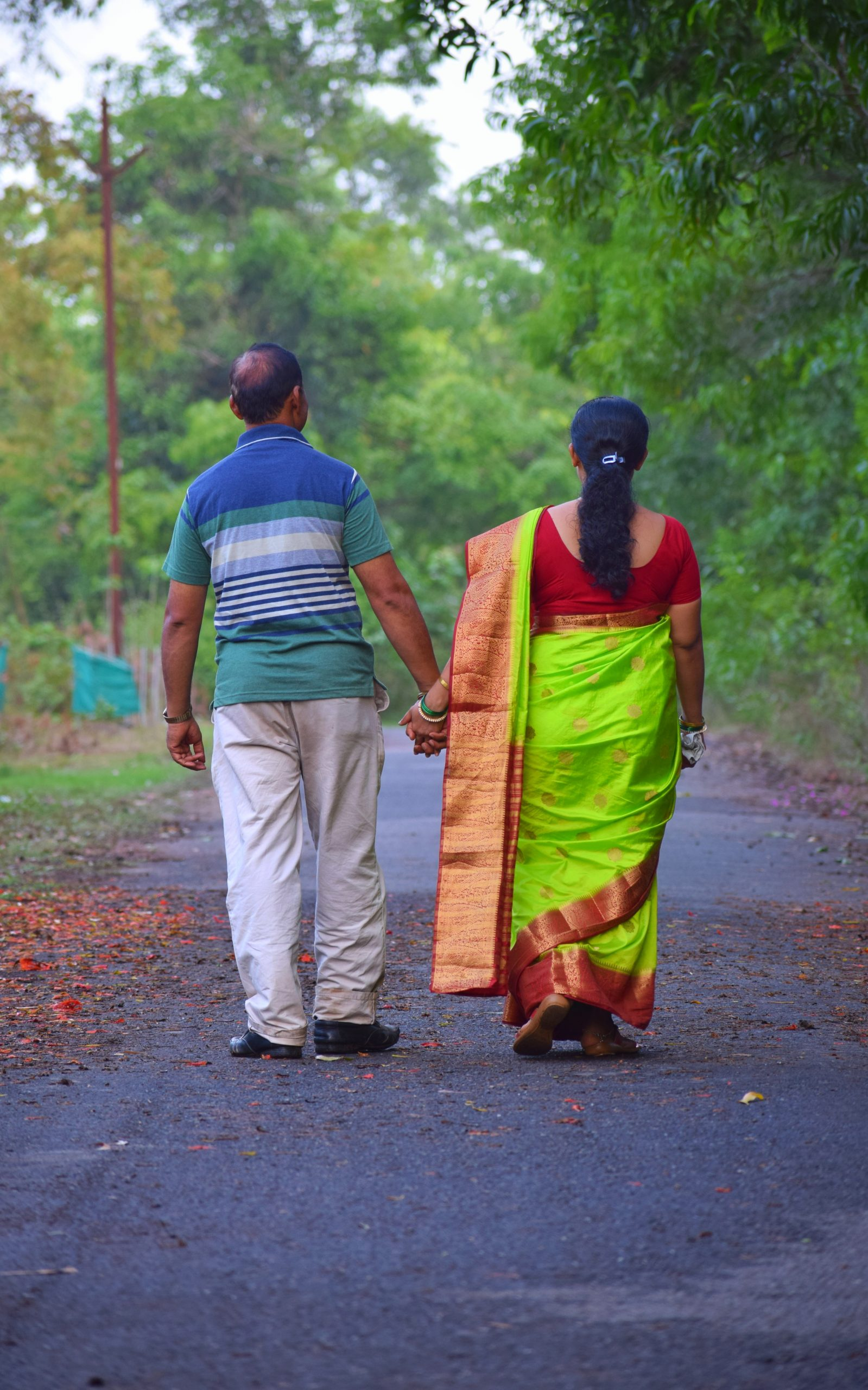 Old Couple walking on the road