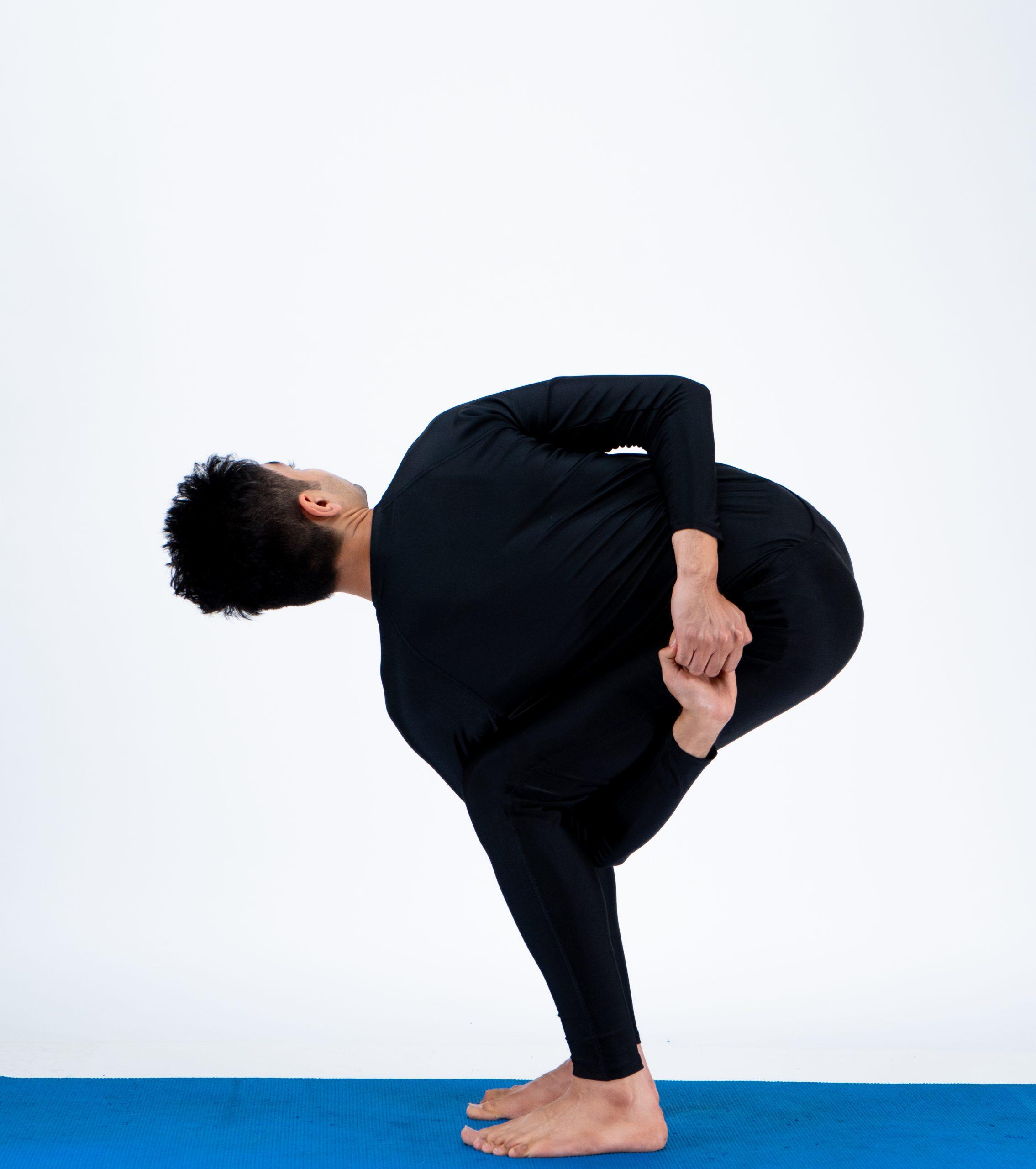 Parivrtta Baddha Utkatasana (Bound Revolved Chair Pose