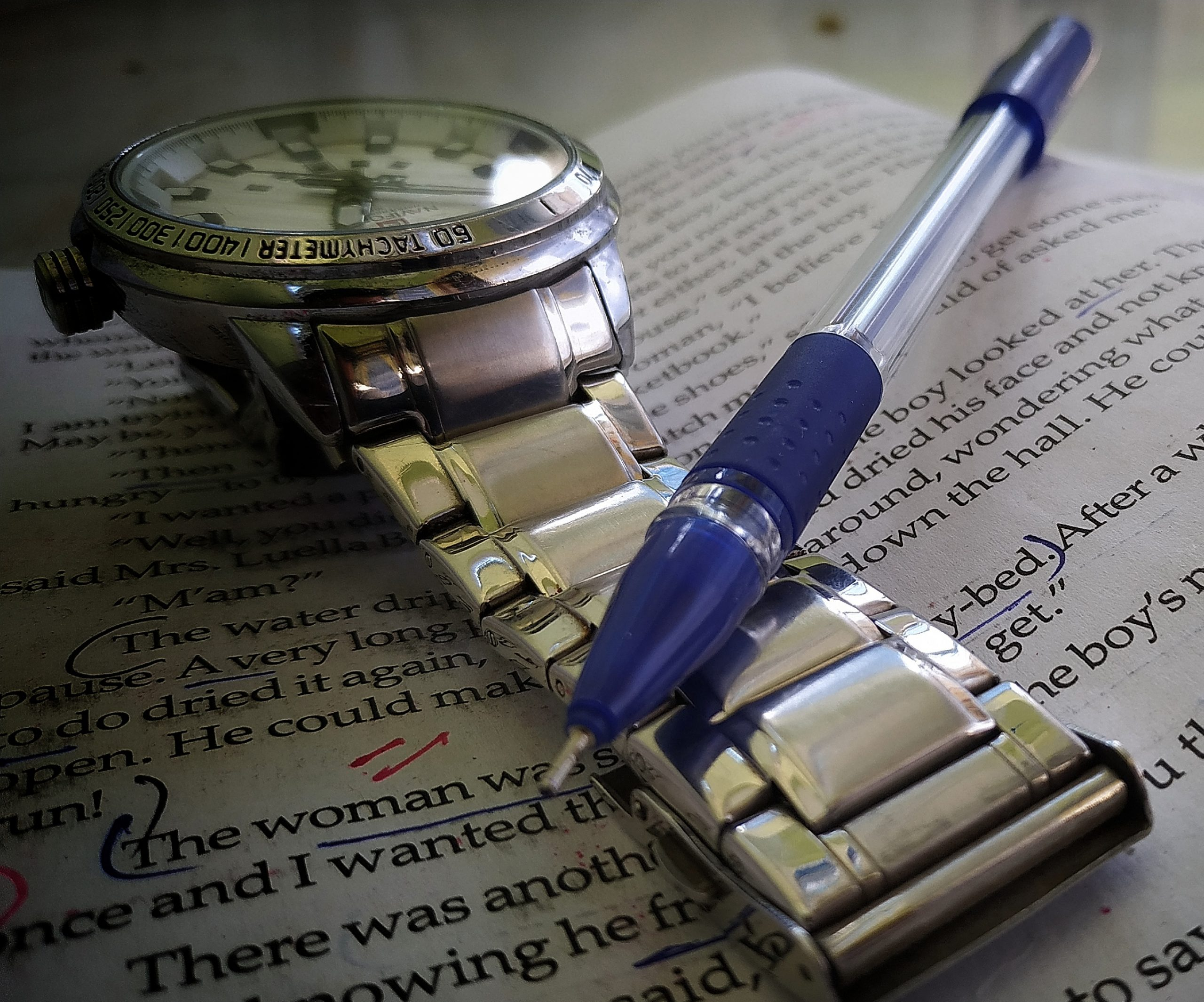 Pen paper and wrist watch