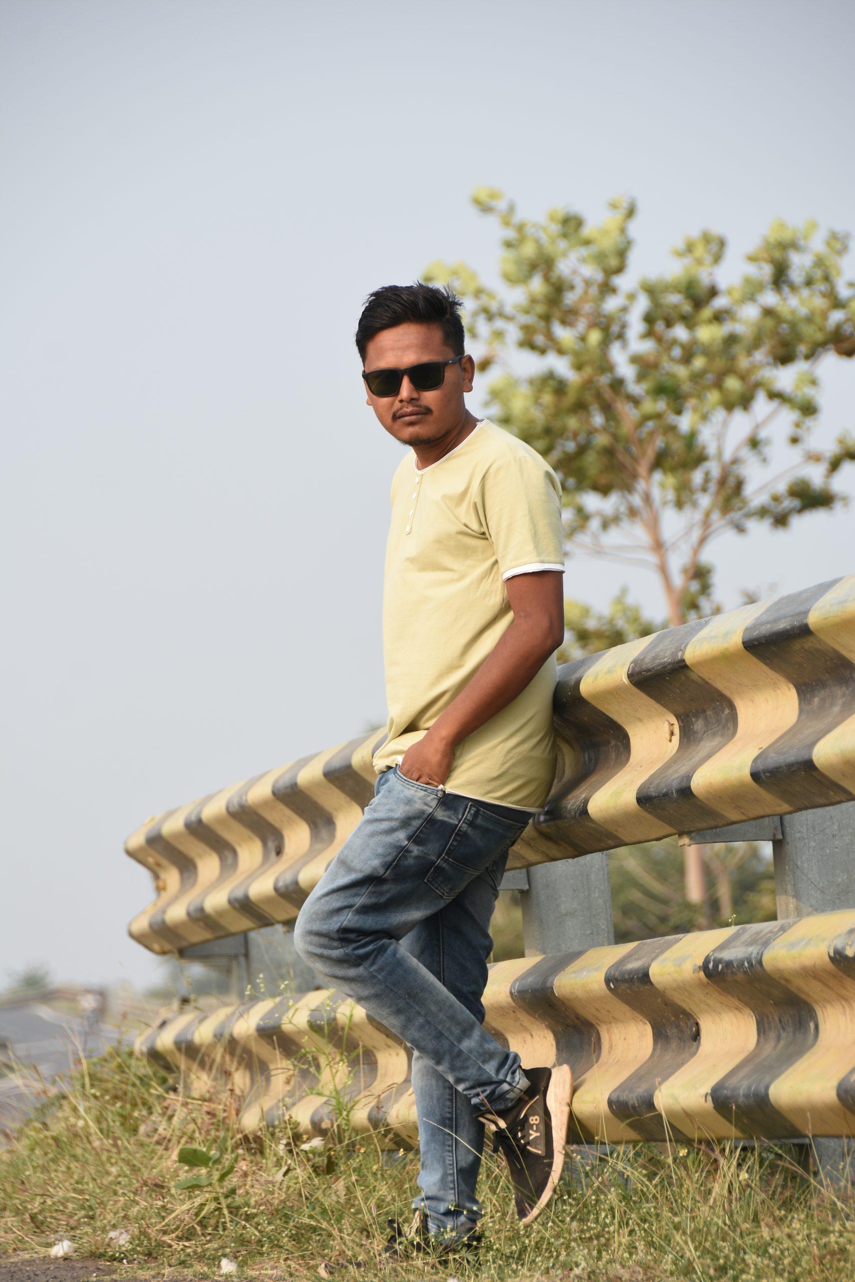 Boy posing near road railing