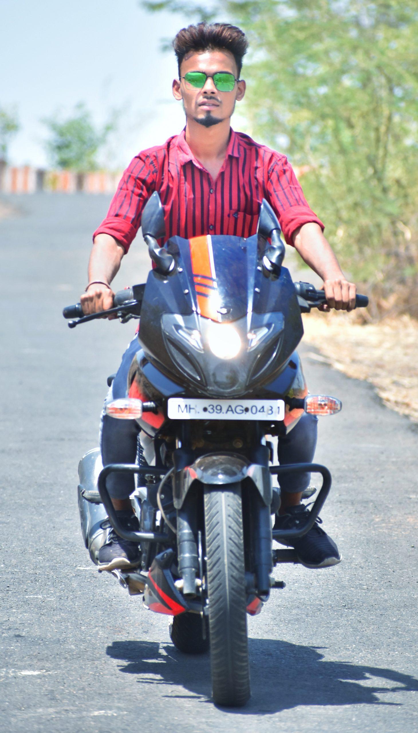 Stylish boy riding pulsar bike