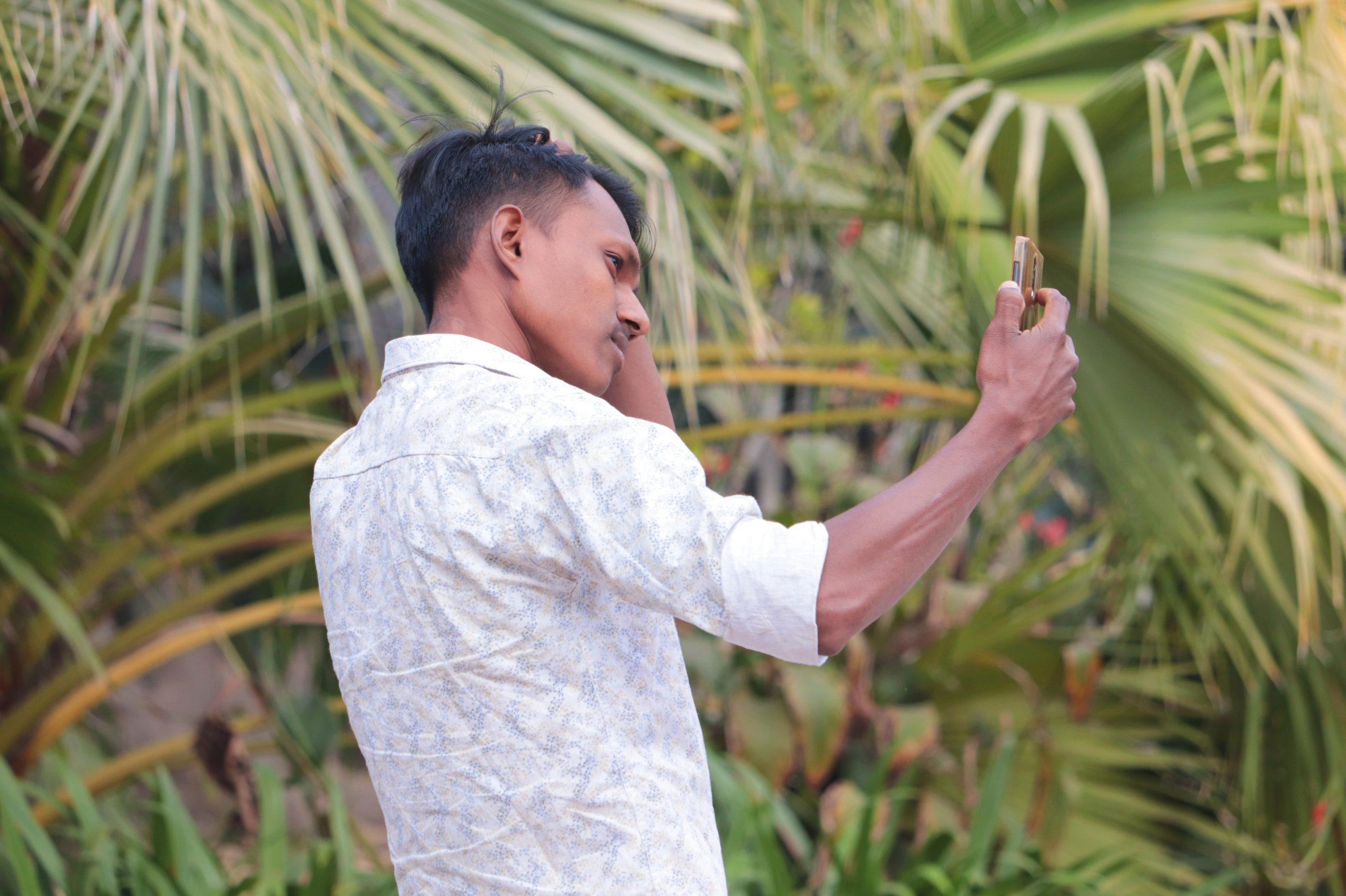 Boy taking selfie in the garden