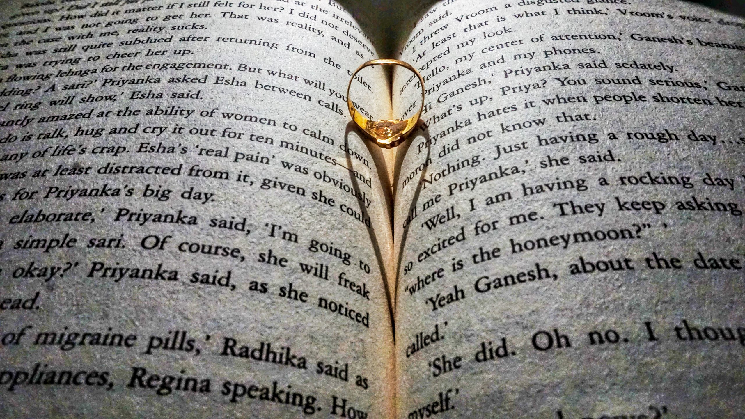 Shadow of a ring on book