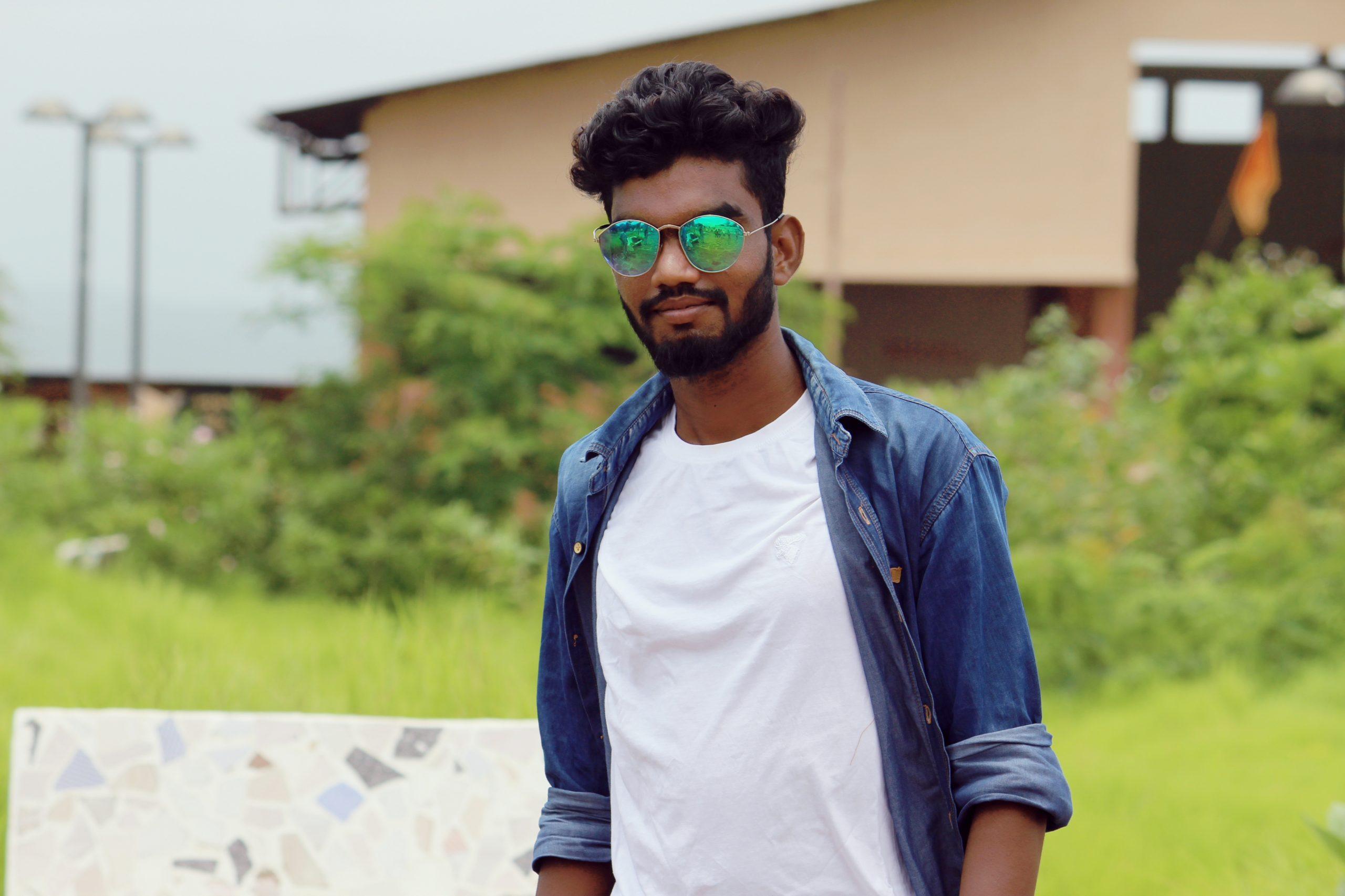 Stylish boy posing with sunglasses