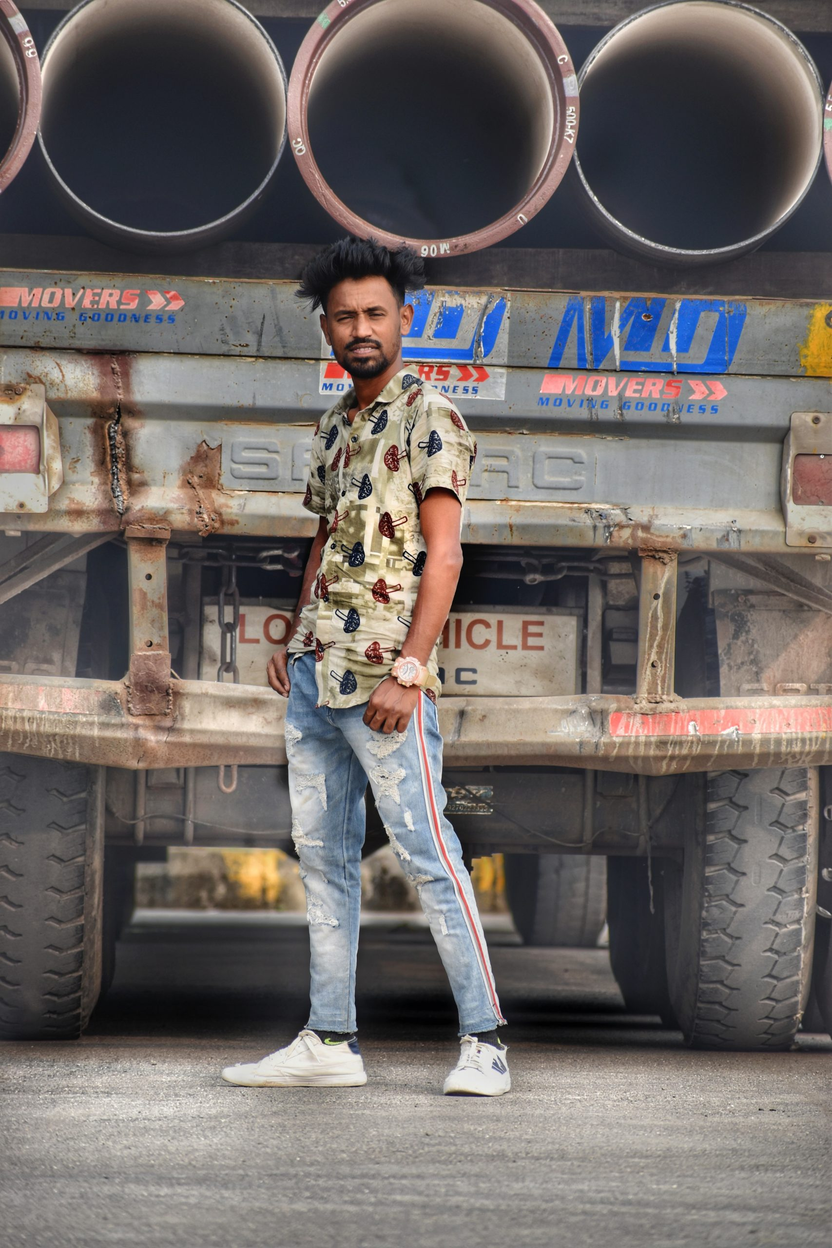Stylish boy posing in front of Truck