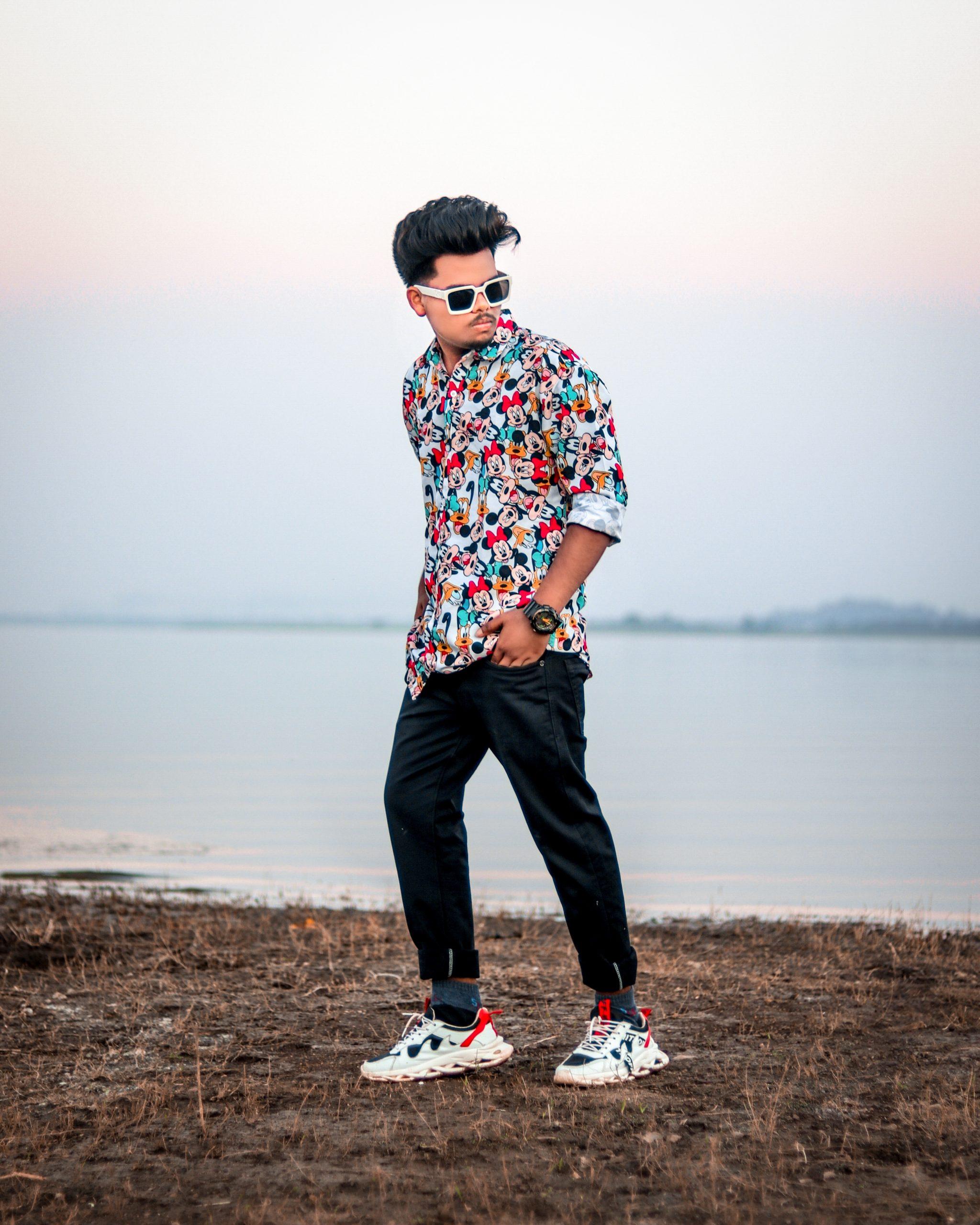 Stylish boy posing near the river