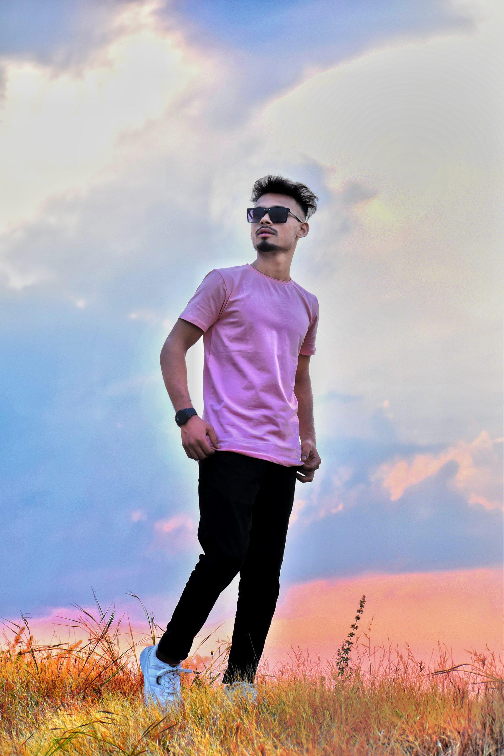 Stylish boy posing under the sky