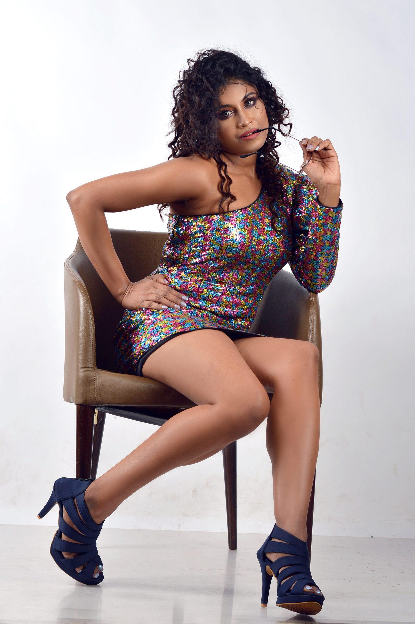 Stylish female model posing in western dress