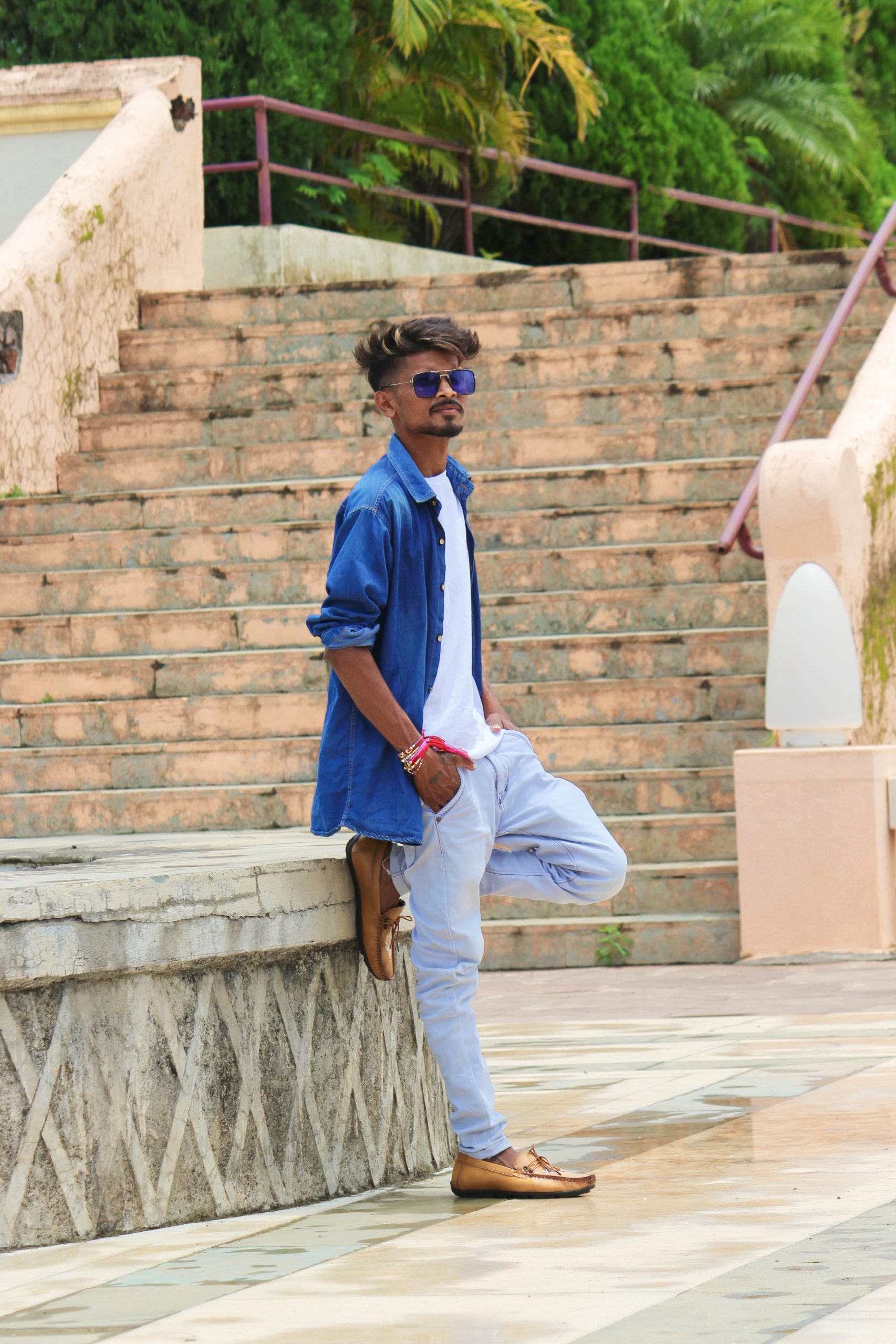 Stylish male model posing near the stairs