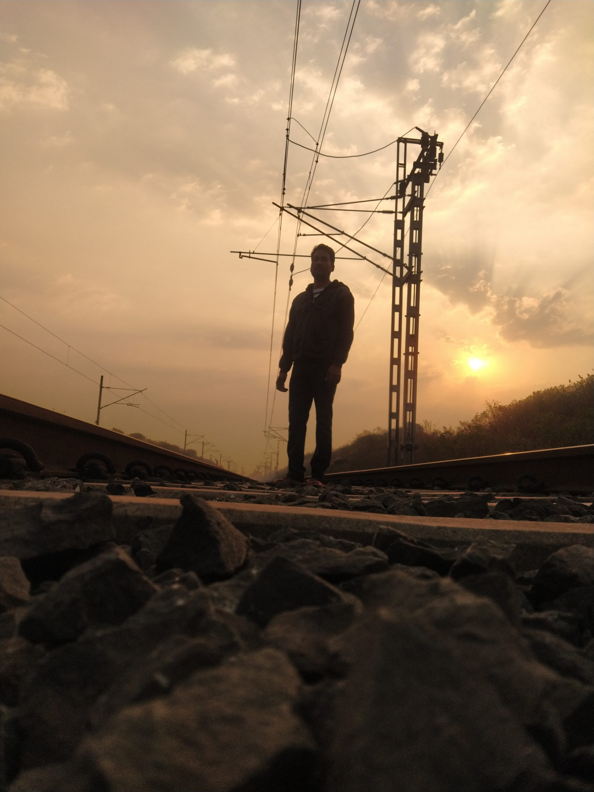 A boy on a railway track