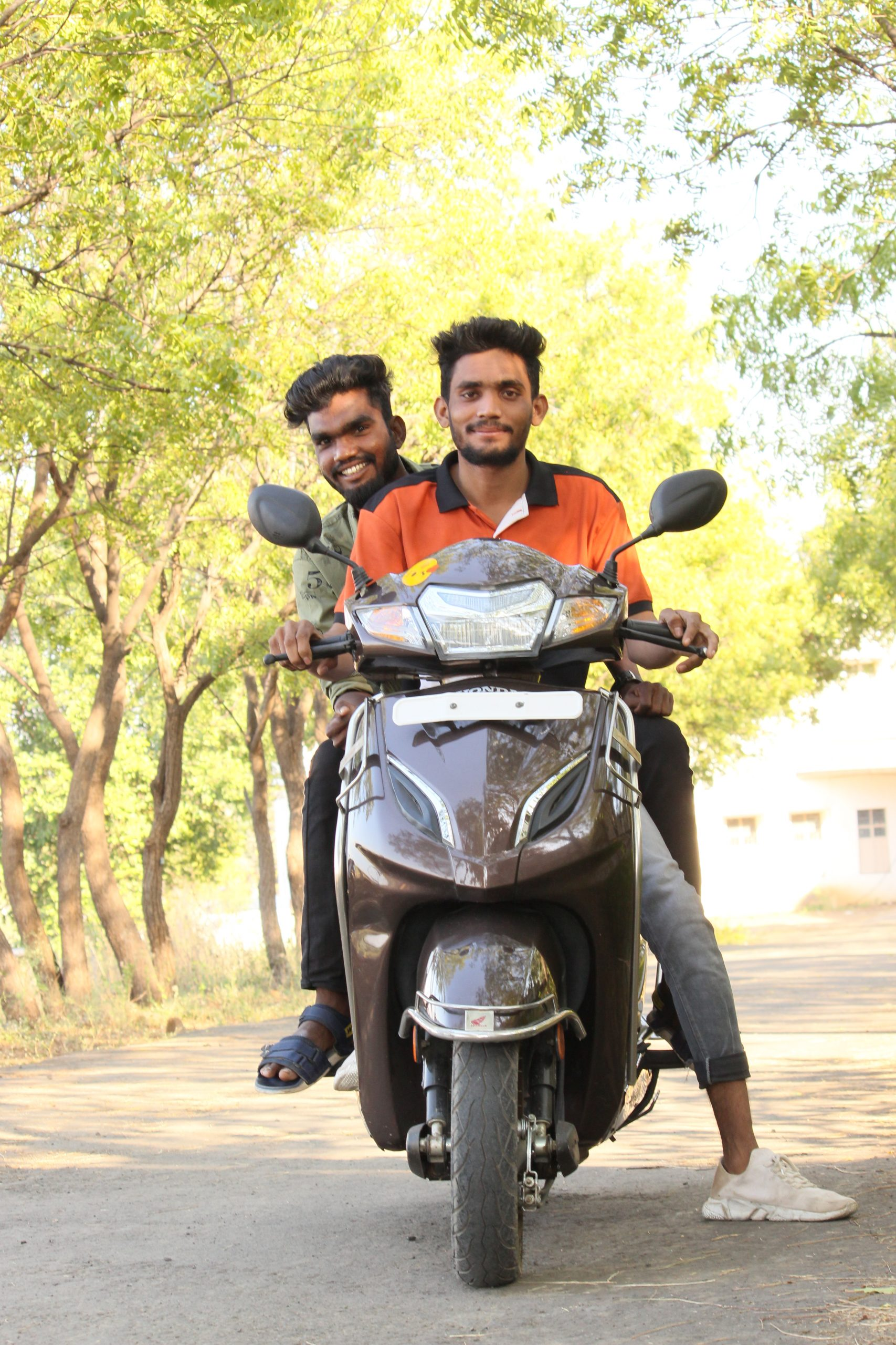 Two boys on scooty