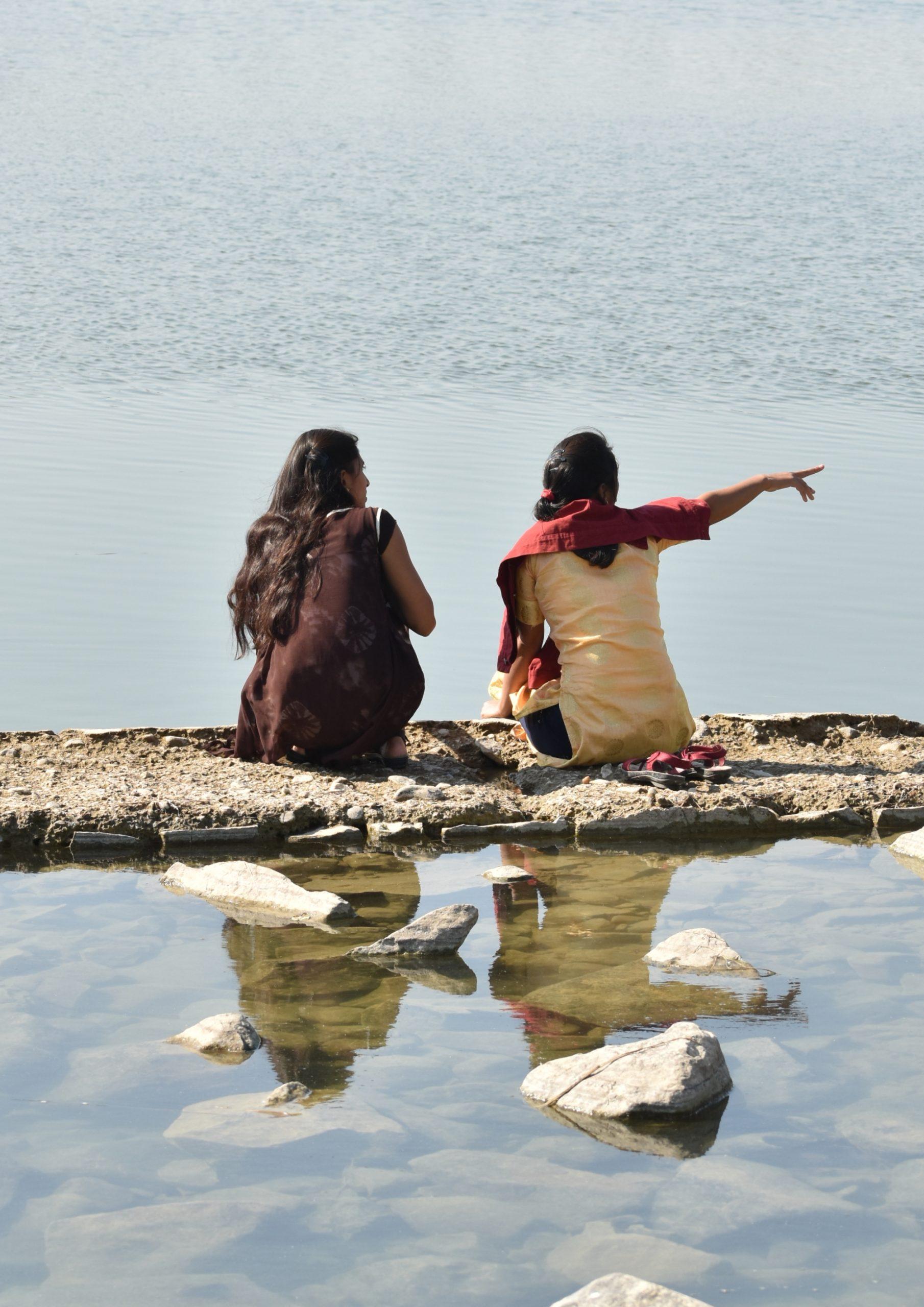 Two girls at riverbank