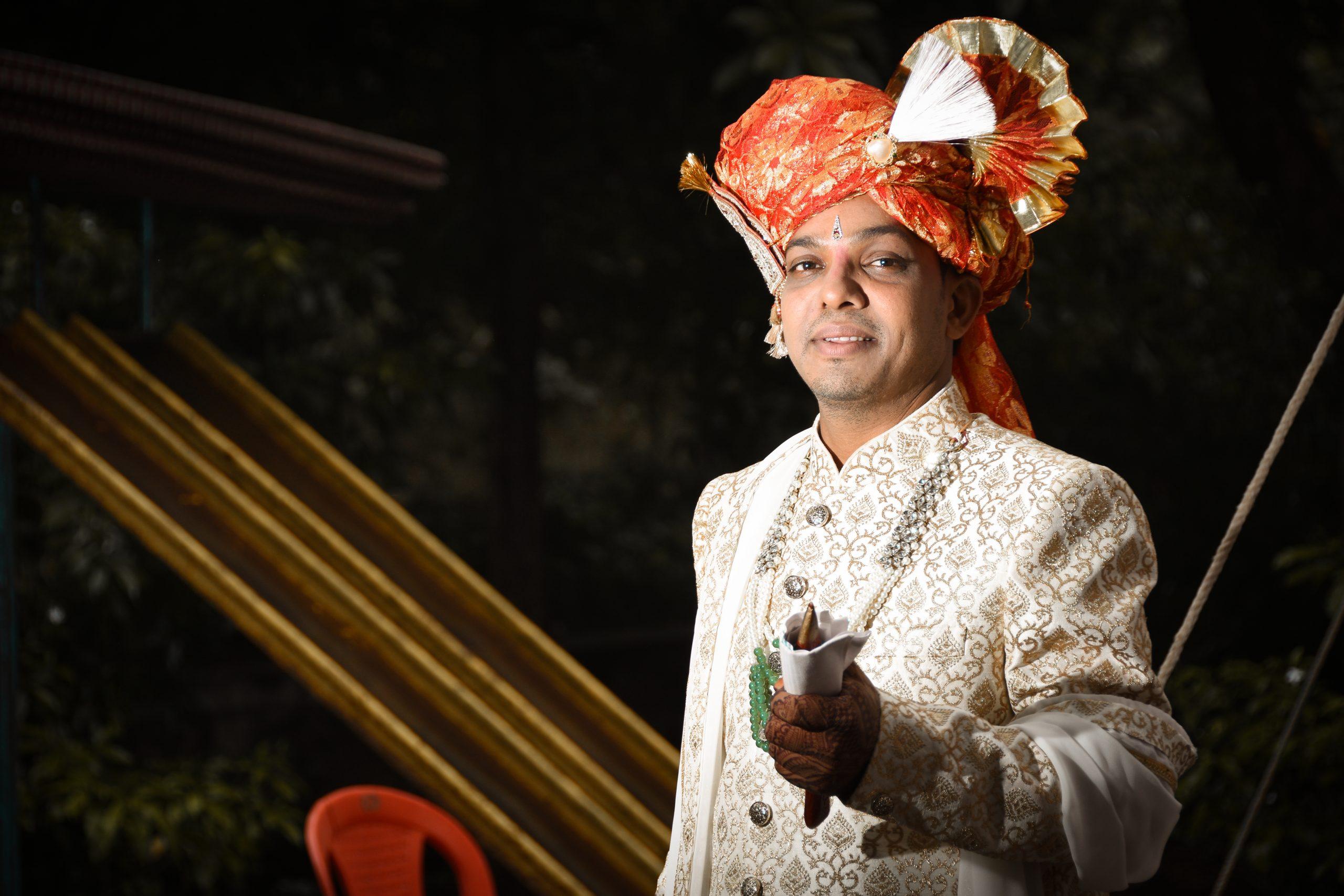 Wedding groom posing