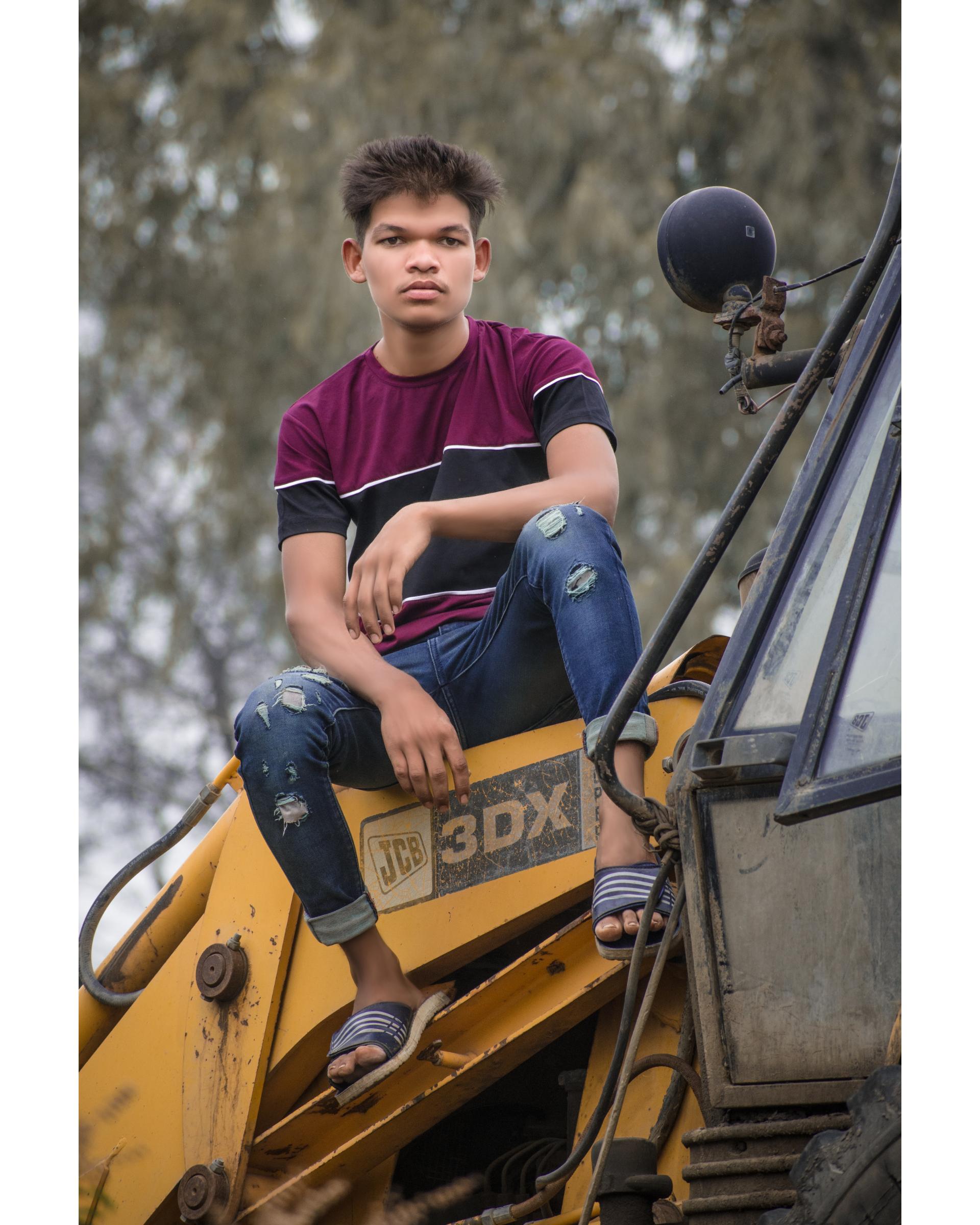A boy on a JCB machine
