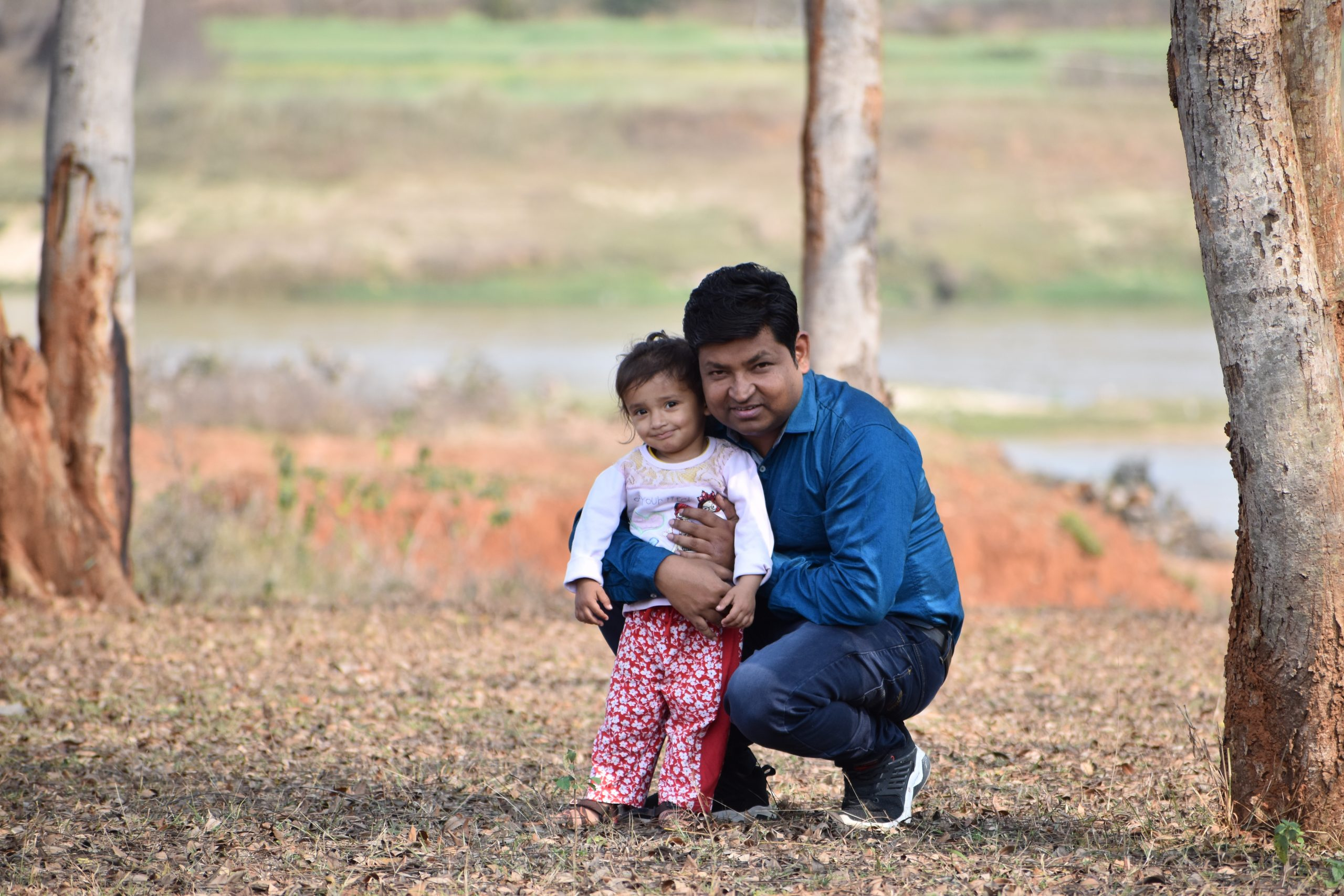 father and baby in the farm