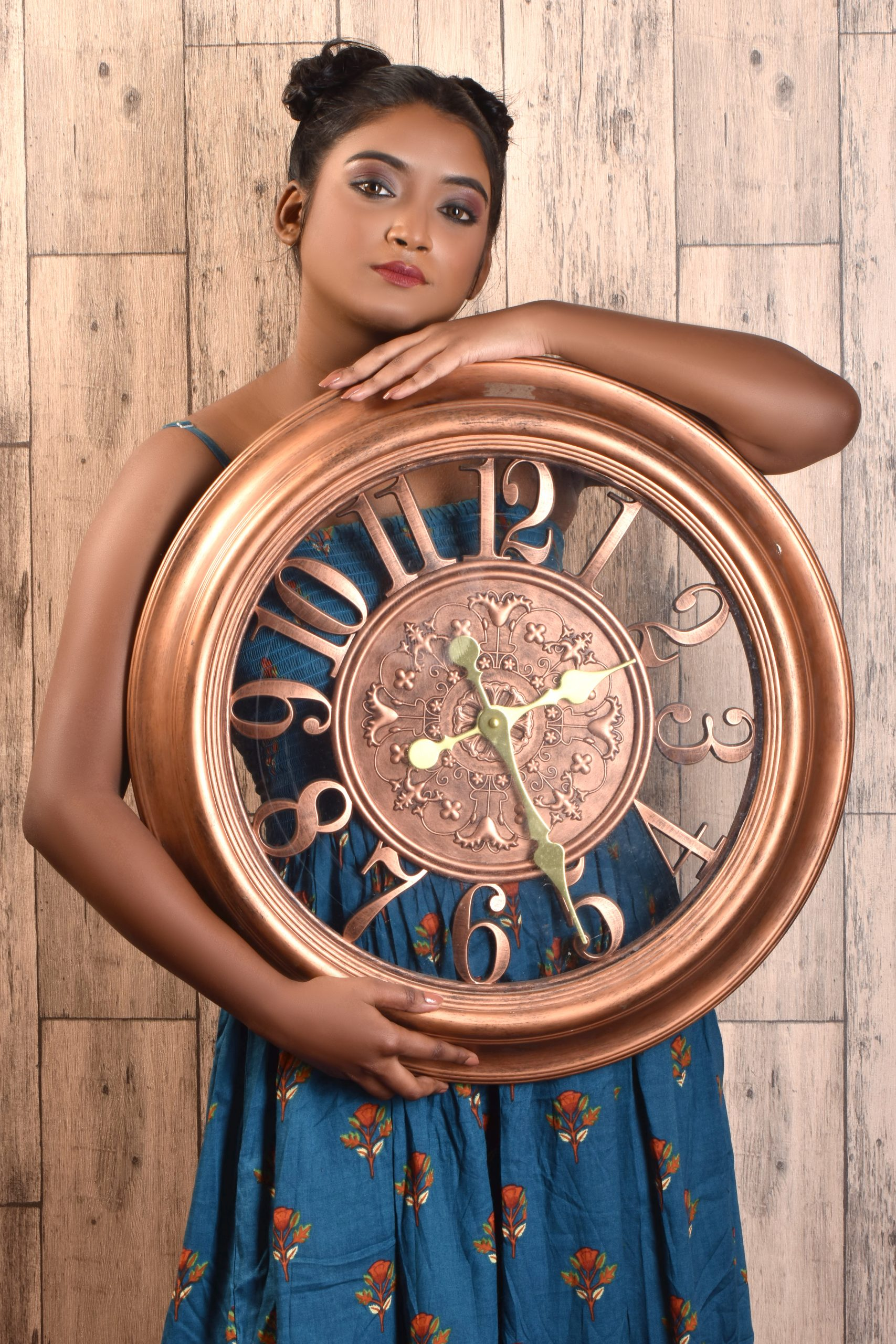 A girl holding a wall clock