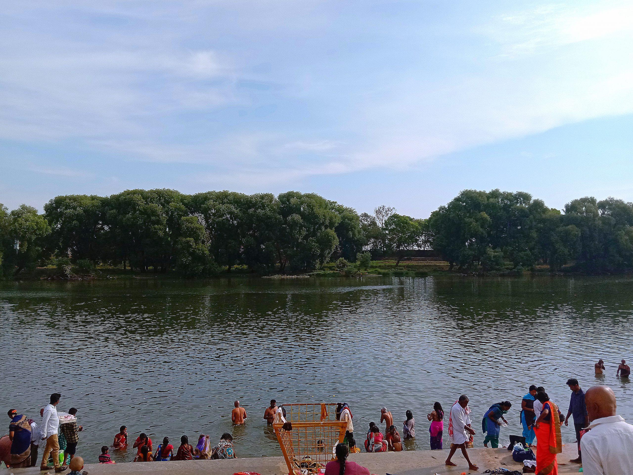 People taking ritual bath in a river