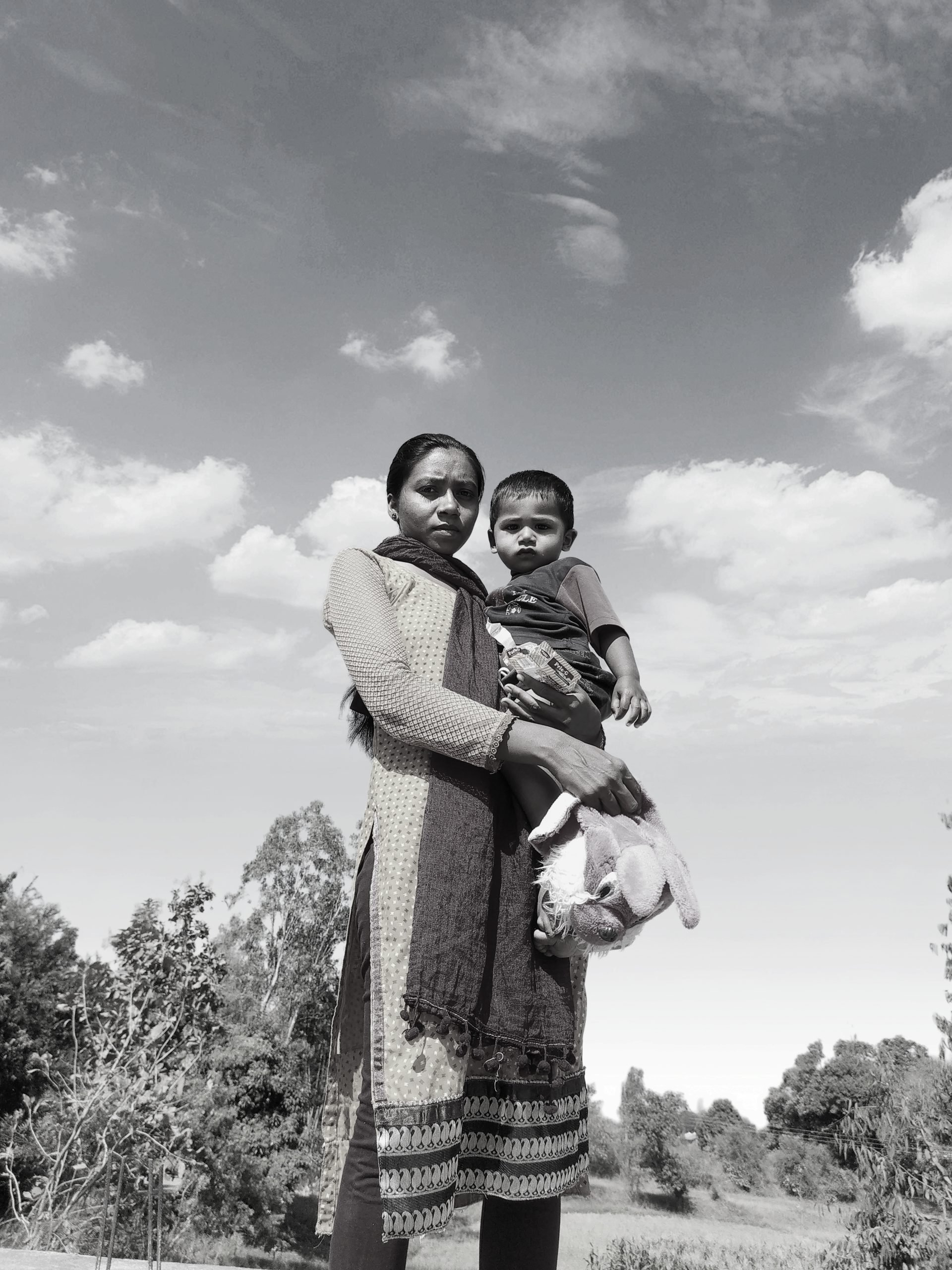 Mother with her child under open sky