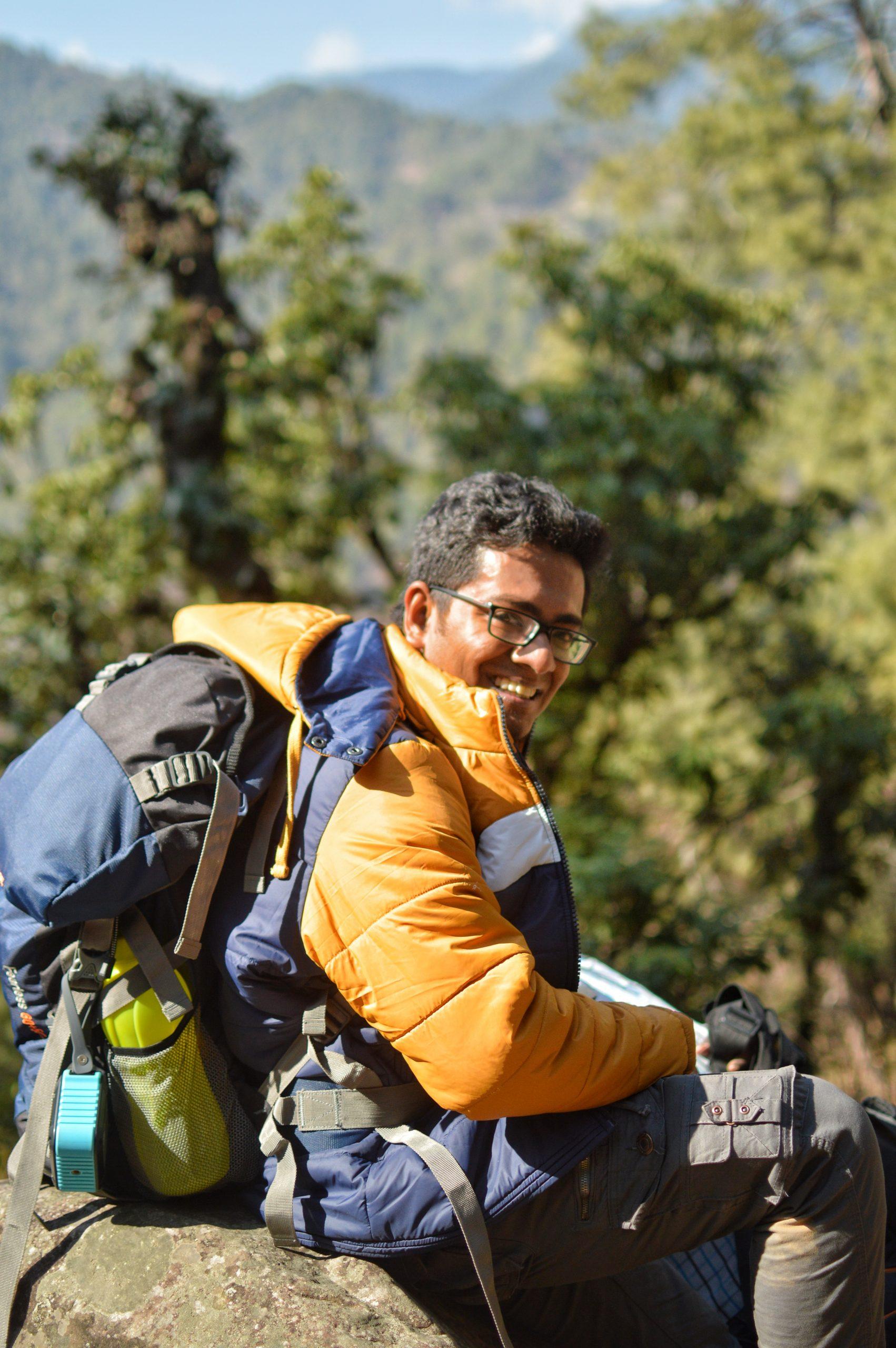 Trekker resting on a rock