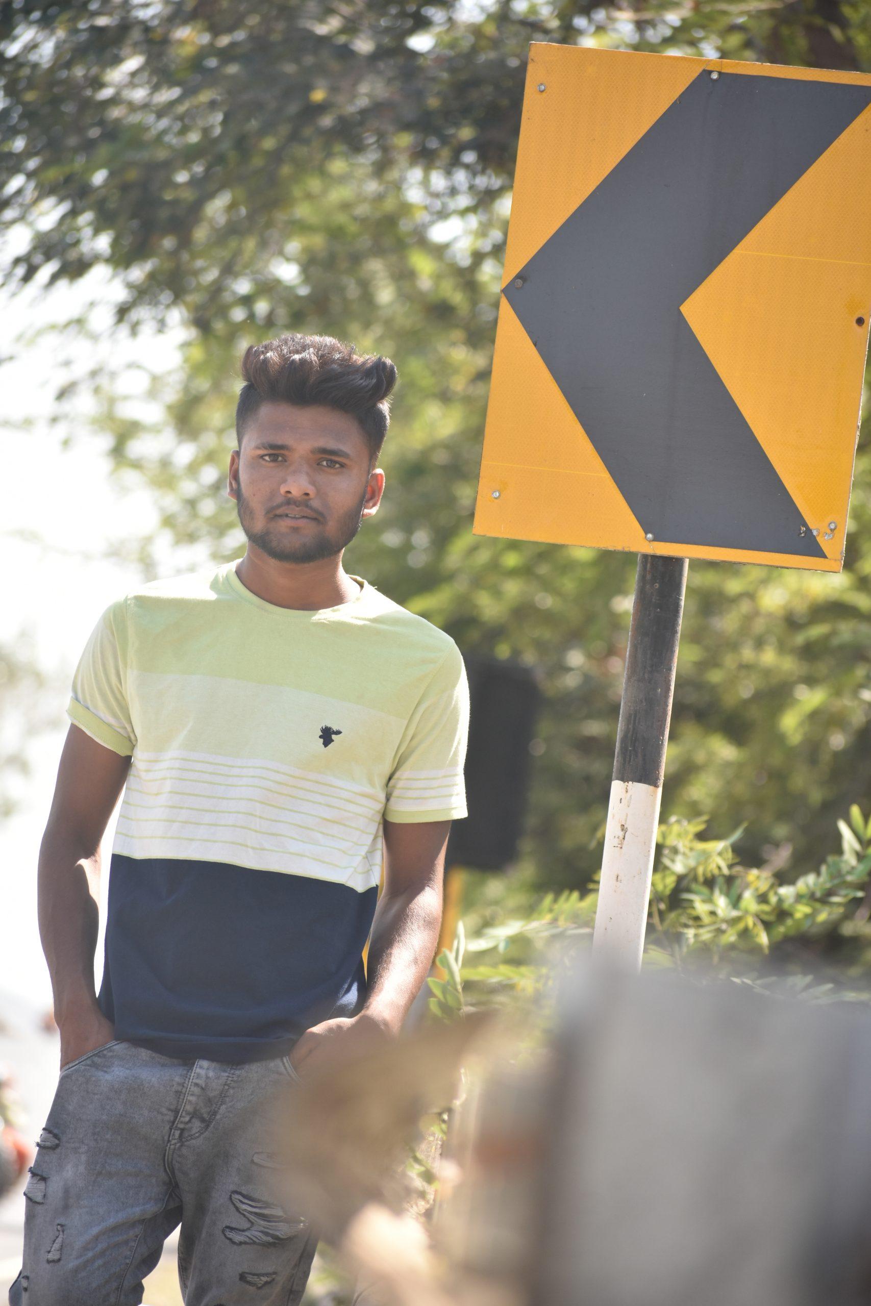 Boy posing roadside