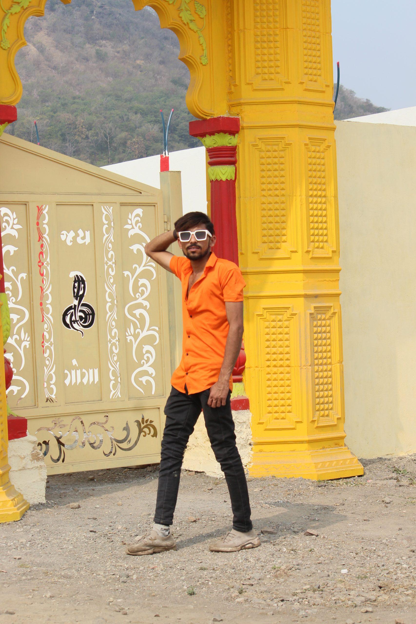 A boy near a gate