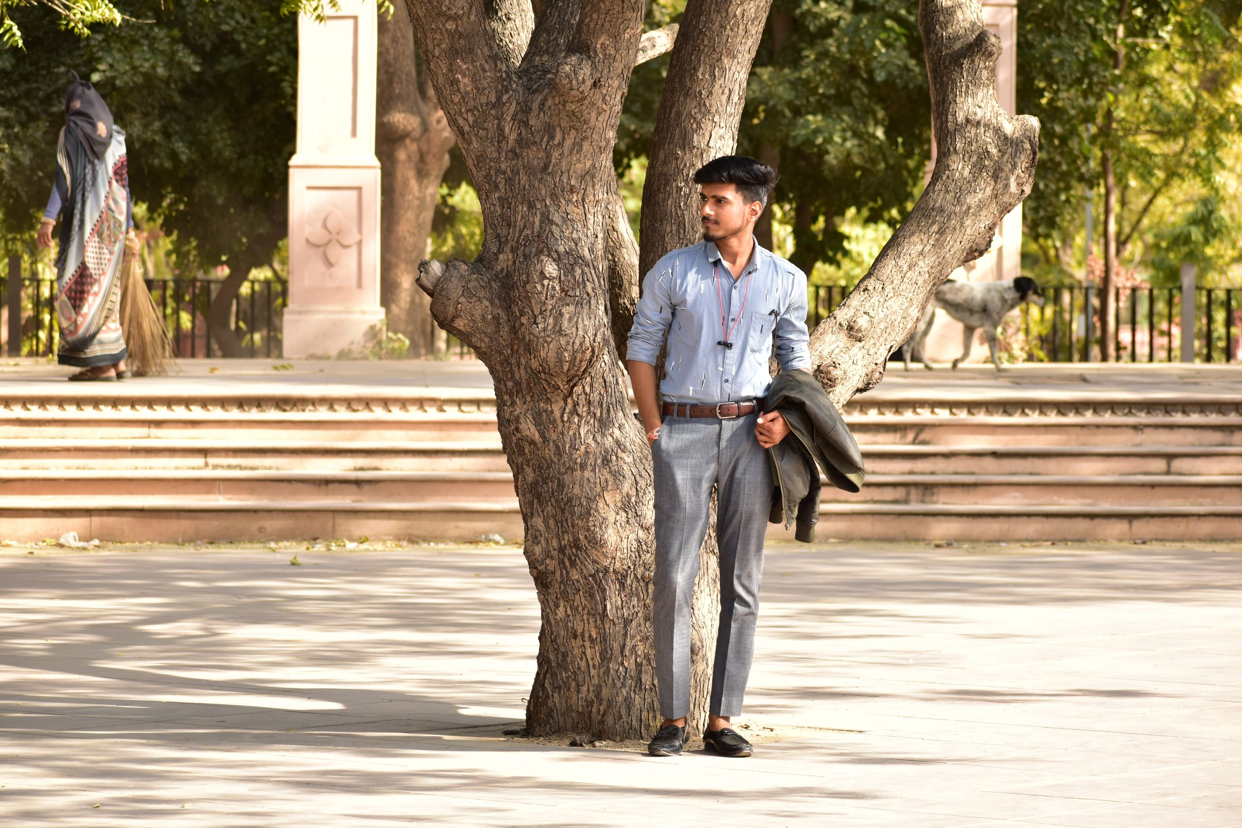 A male model under a tree