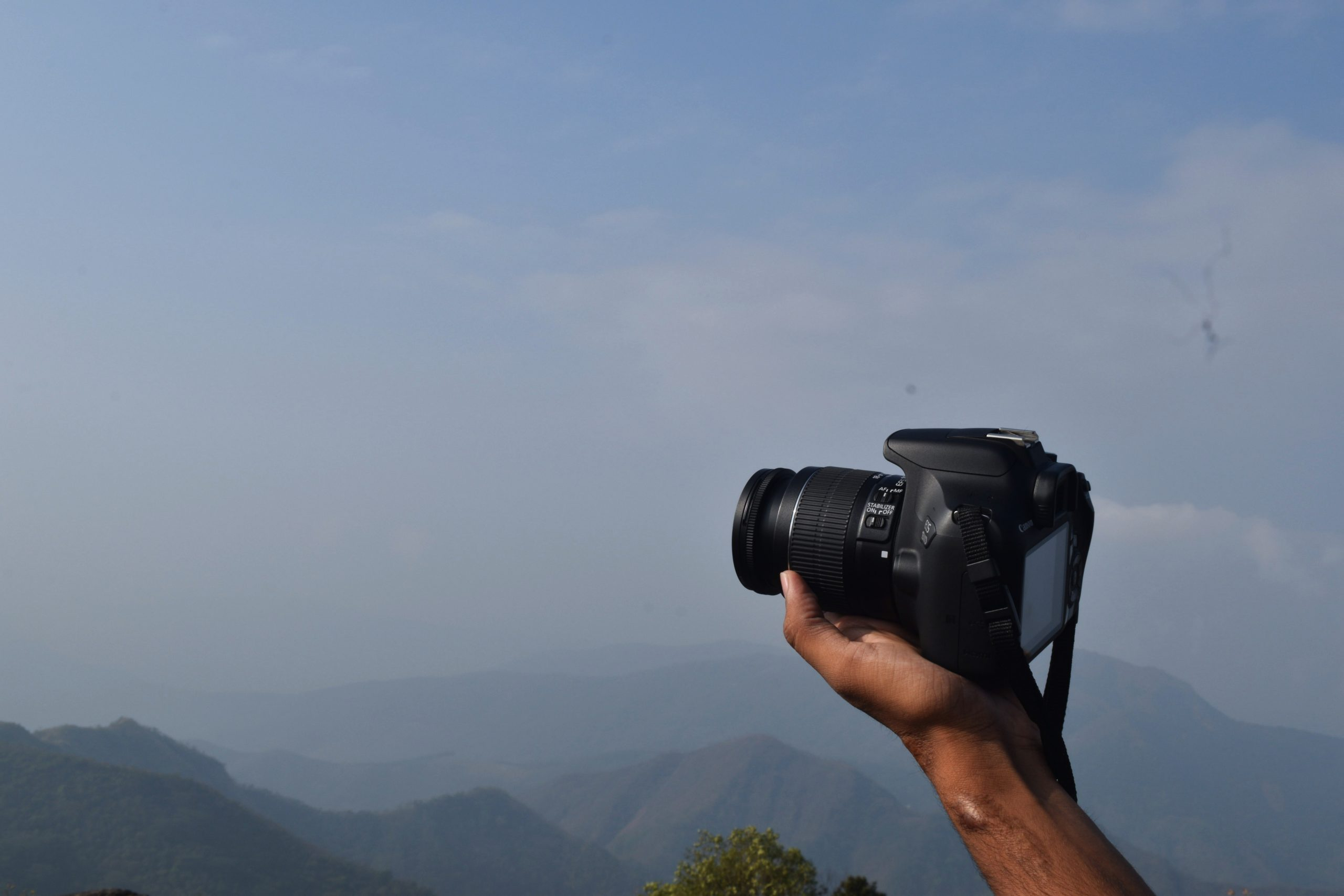Camera in hand in the mountains