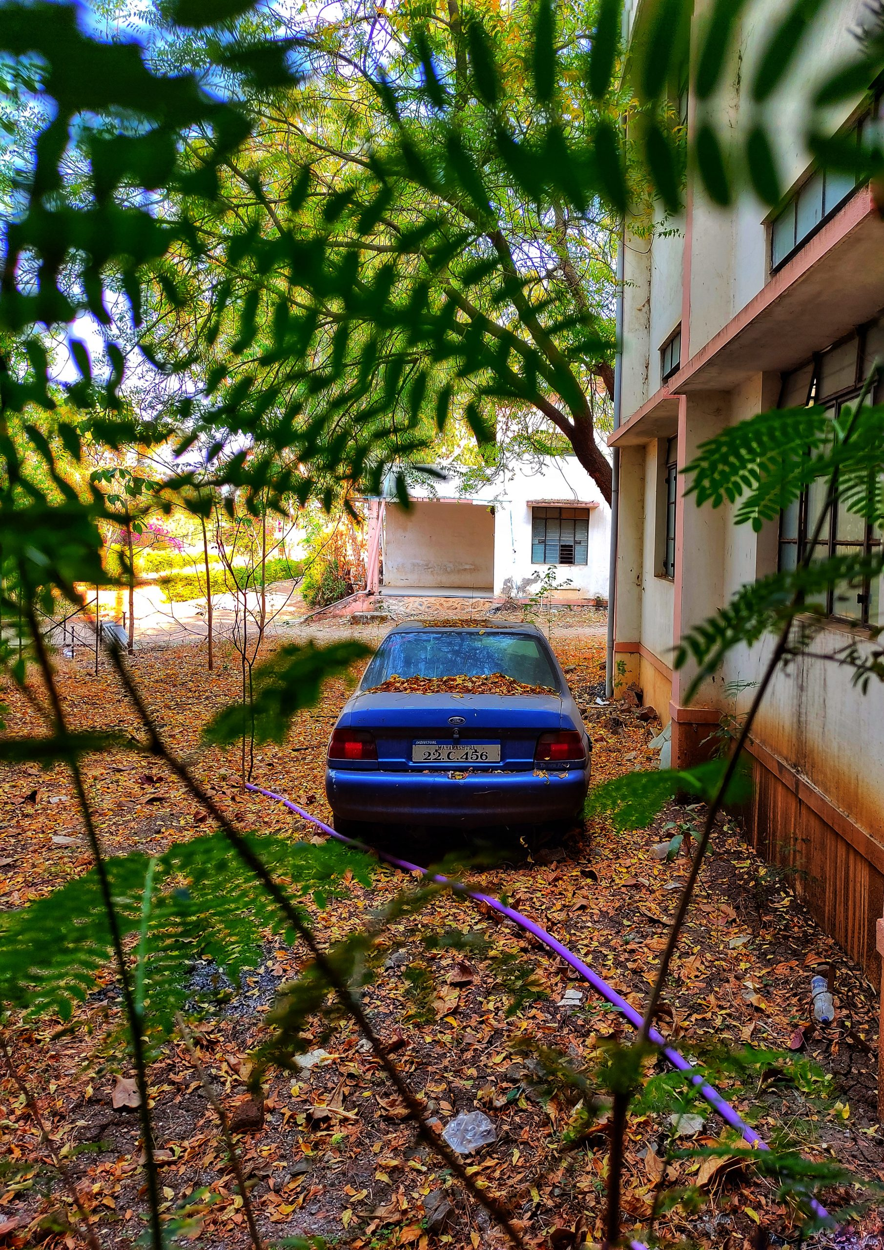 A car parked behind a house