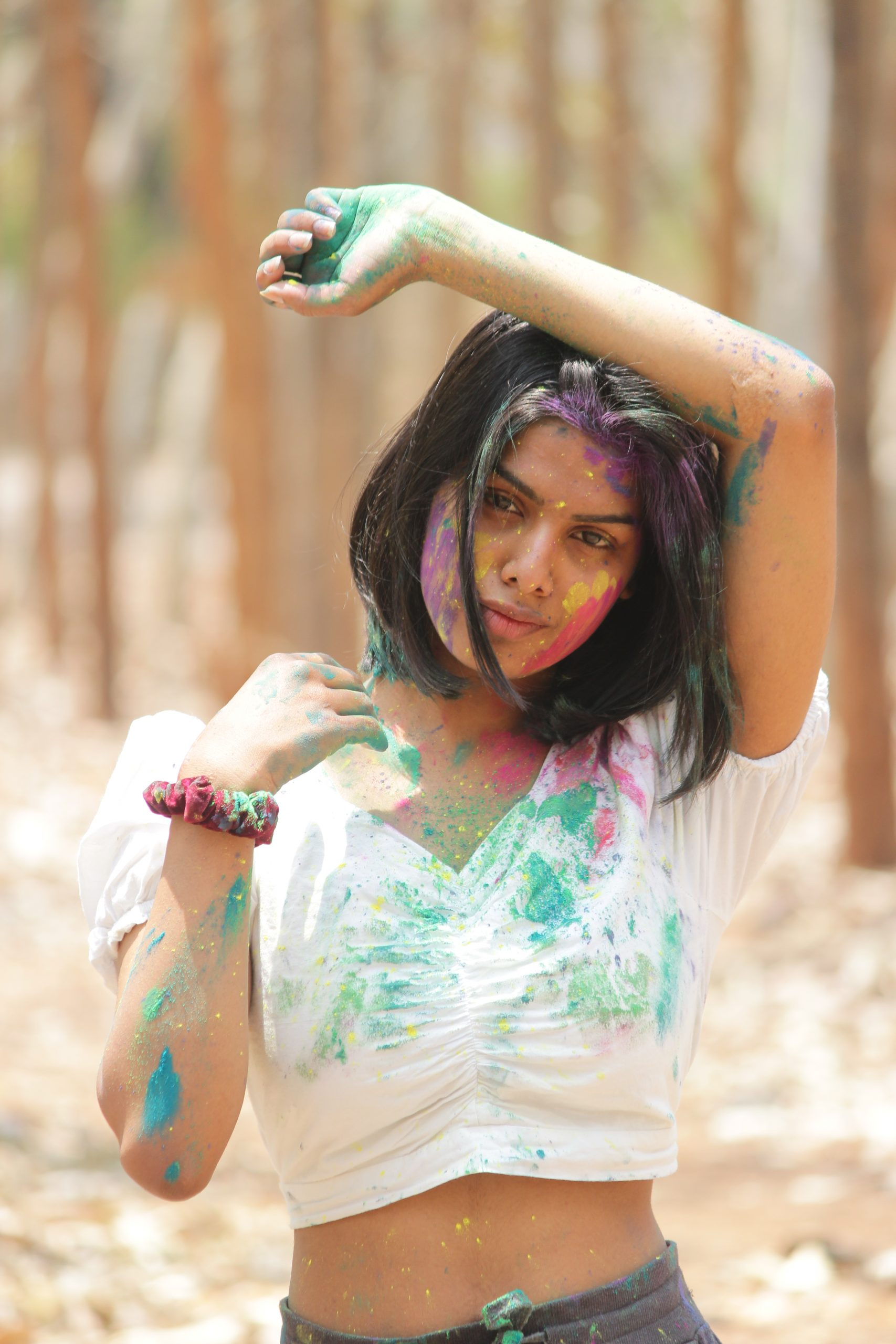 A fashion model celebrating Holi festival