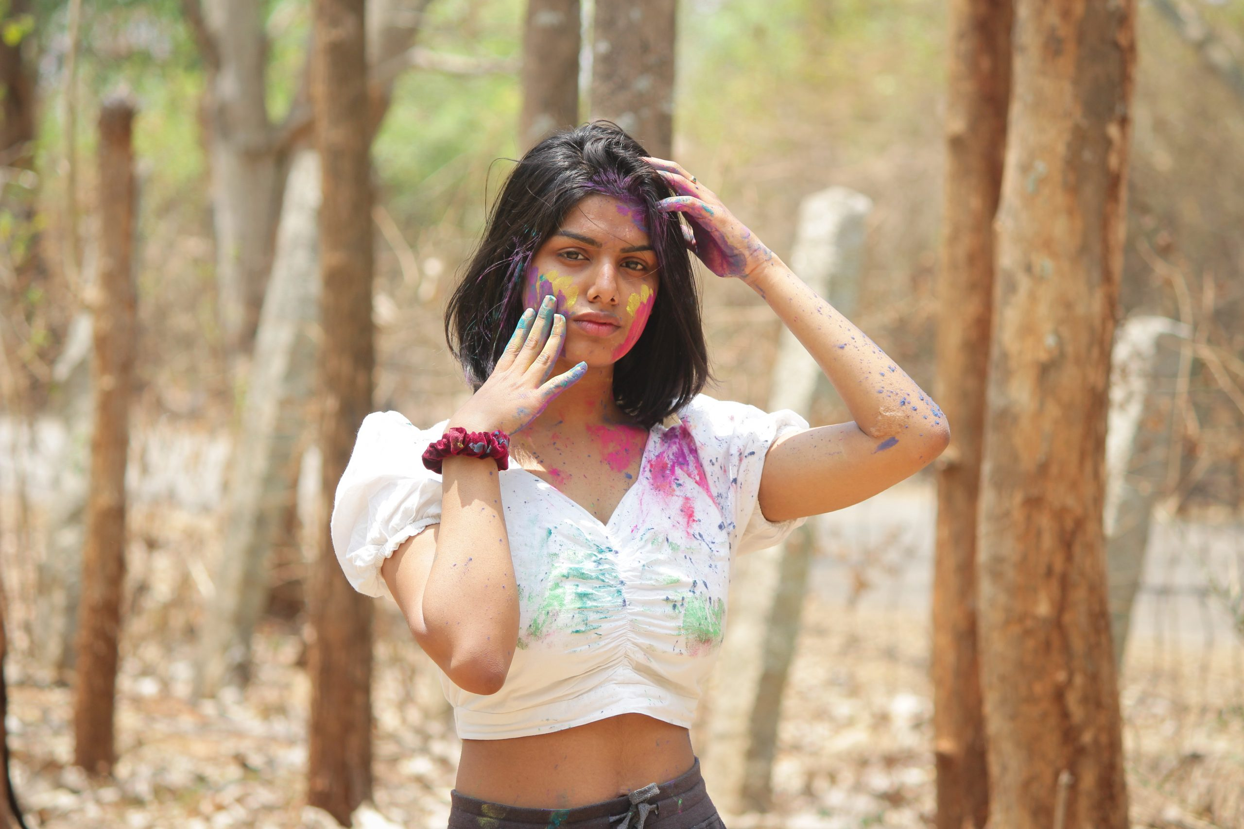 A fashion model playing with Holi colors