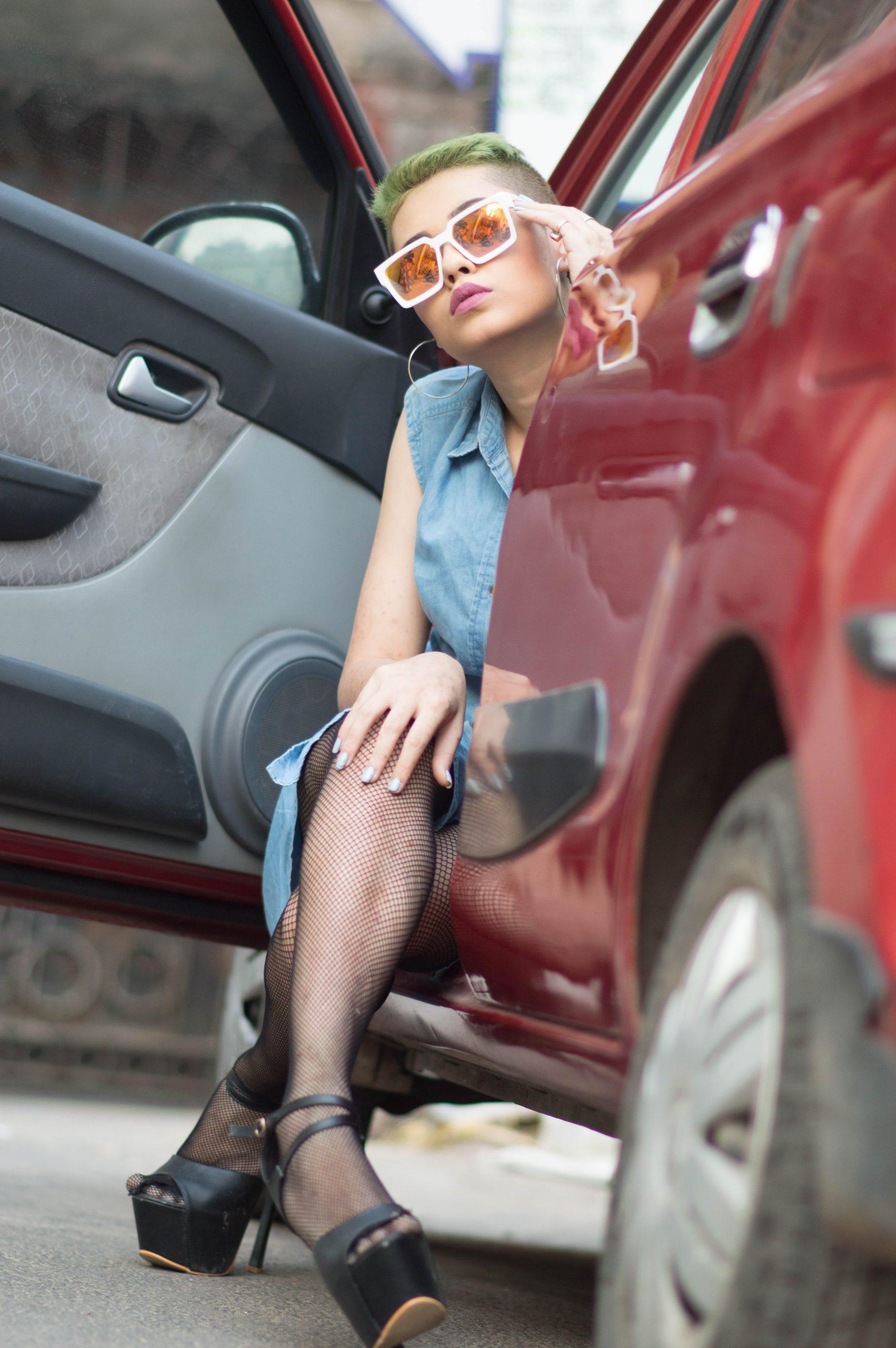A female model at car door