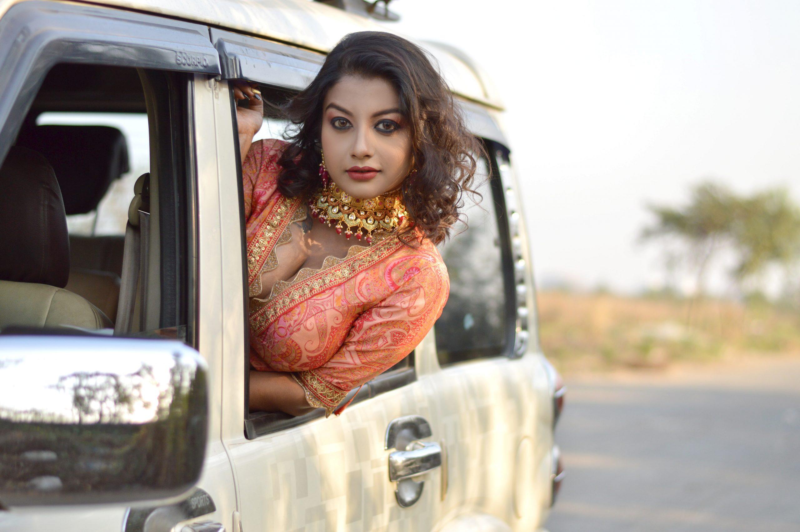 A girl peeking from a car window
