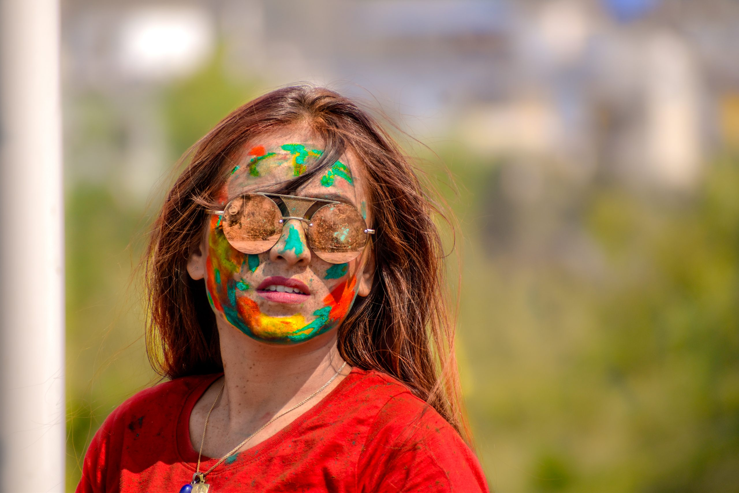 A girl's face painted with Holi colors
