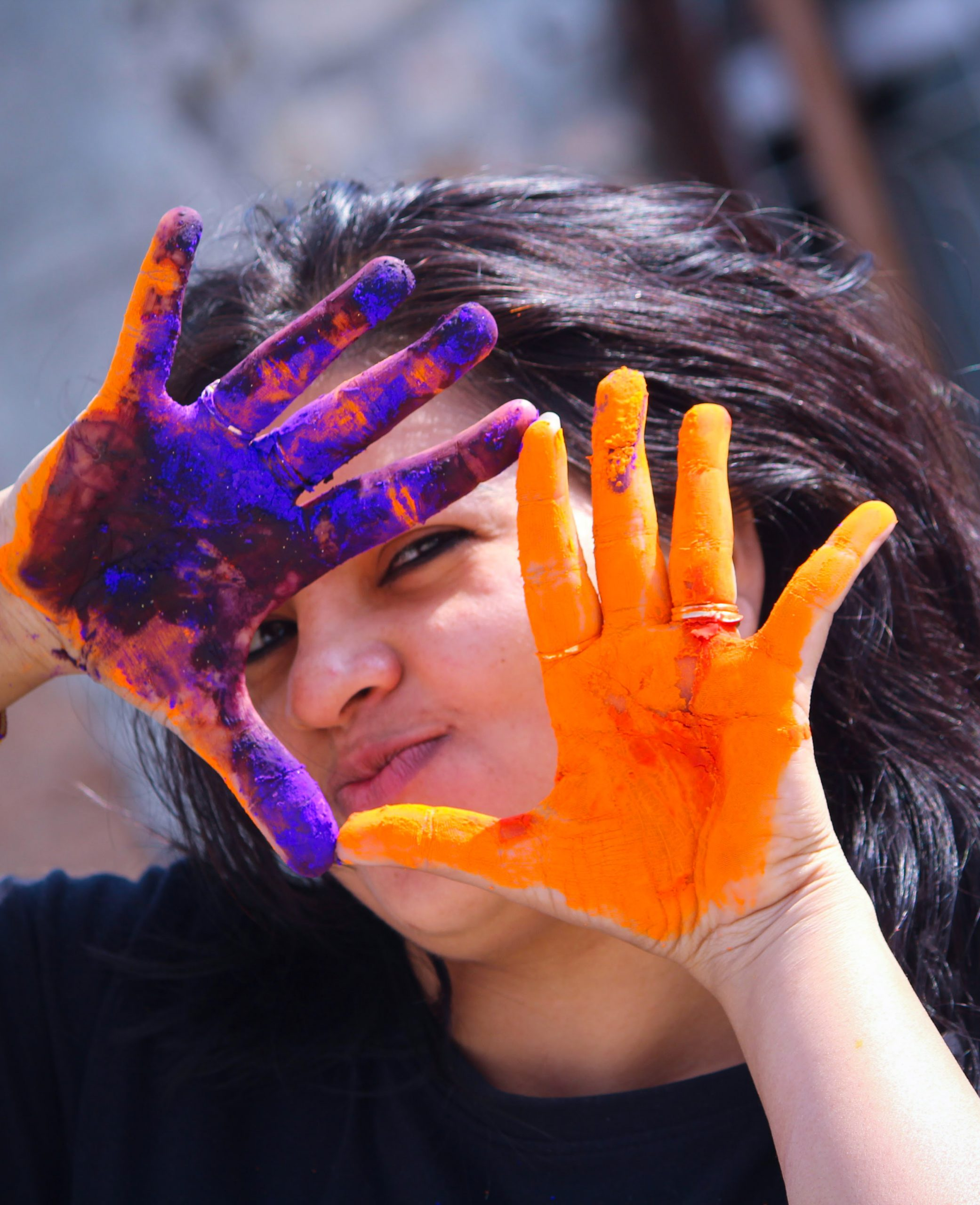 A girl's hands painted with Holi colors
